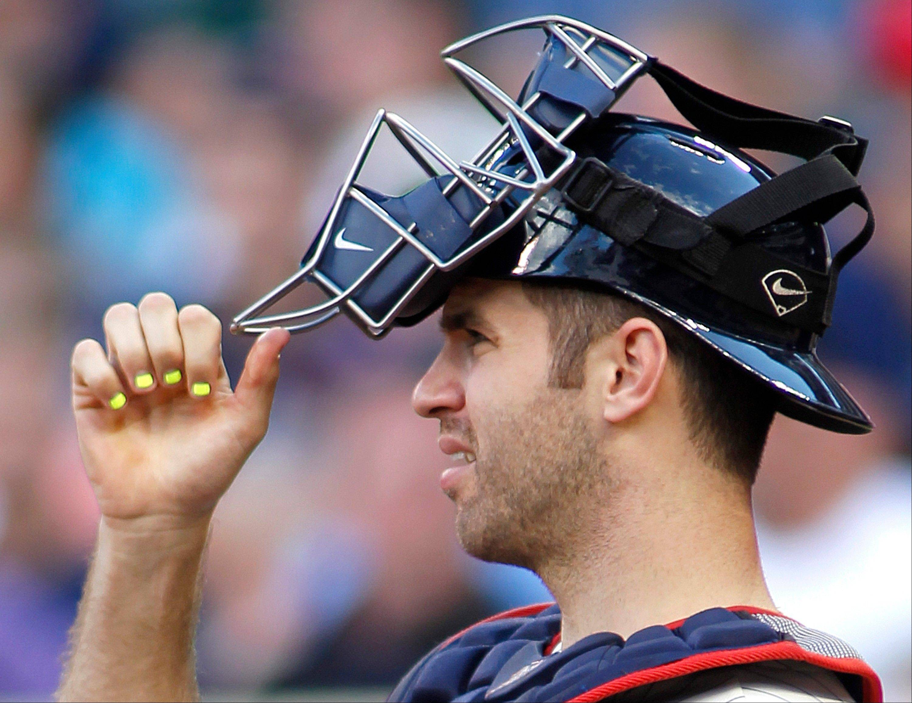 Minnesota�s Joe Mauer, with highlighter coloring his fingernails to show signs to the pitcher, won three Gold Gloves as a catcher.