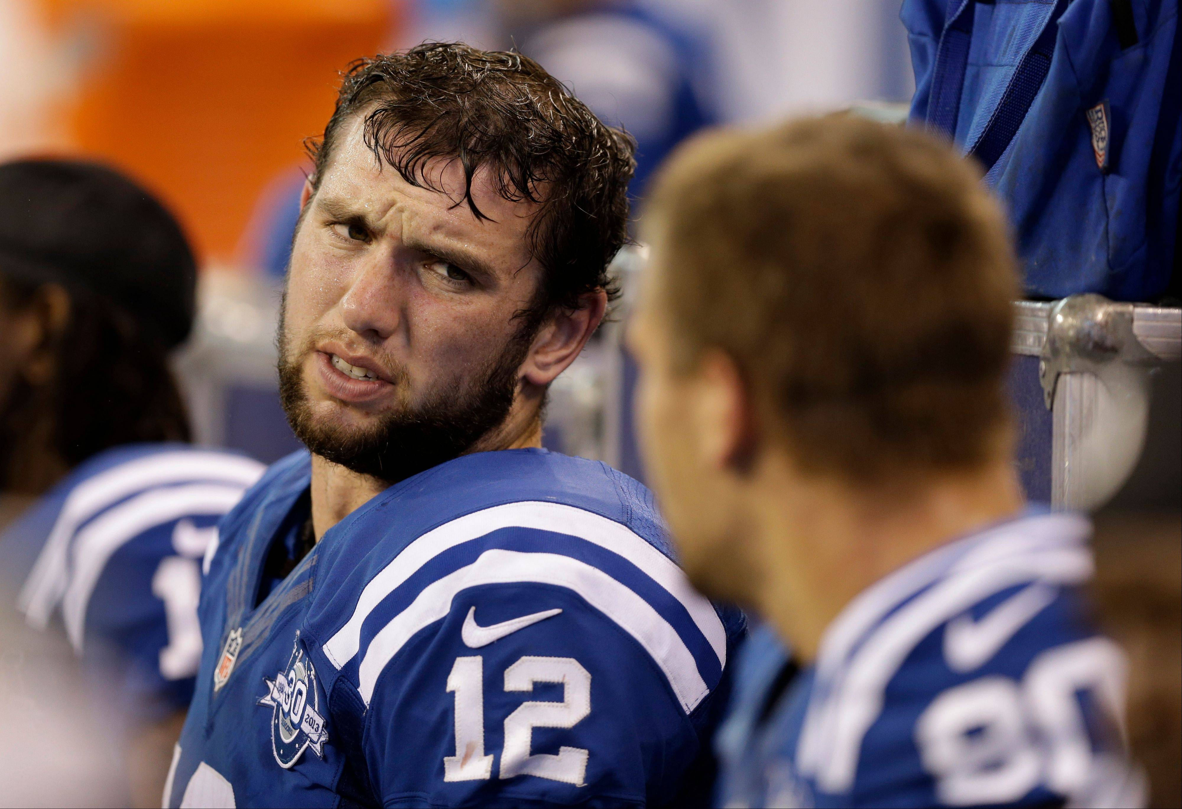 Indianapolis Colts quarterback Andrew Luck, left, talks Sunday with tight end Coby Fleener in the final minutes of the second half of an NFL football game against the St. Louis Rams in Indianapolis, Sunday, Nov. 10, 2013. The Rams defeated the Colts 38-8.(AP Photo/Darron Cummings)