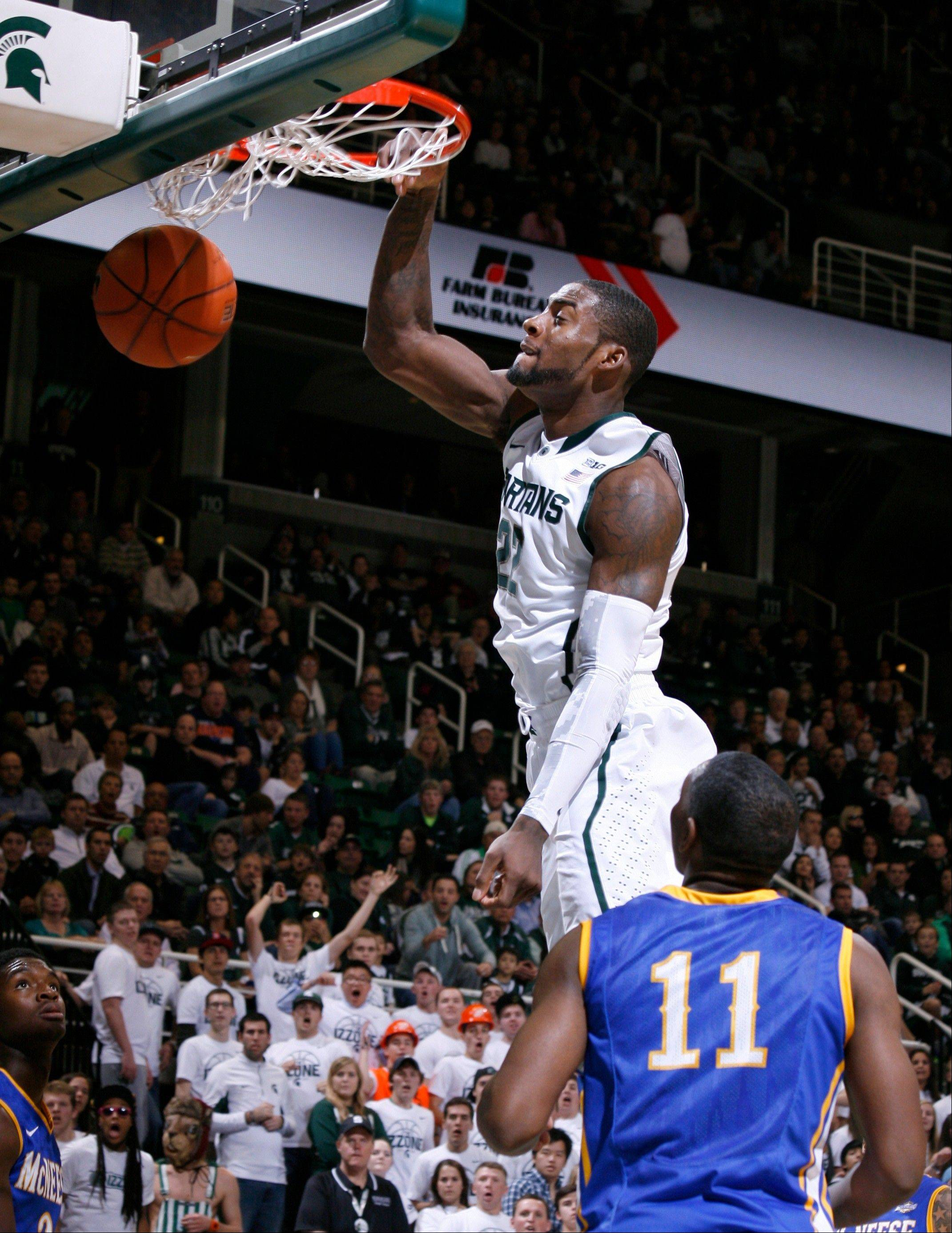 Michigan State�s Branden Dawson dunks over McNeese State�s Kevin Hardy Friday during the second half in East Lansing, Mich.