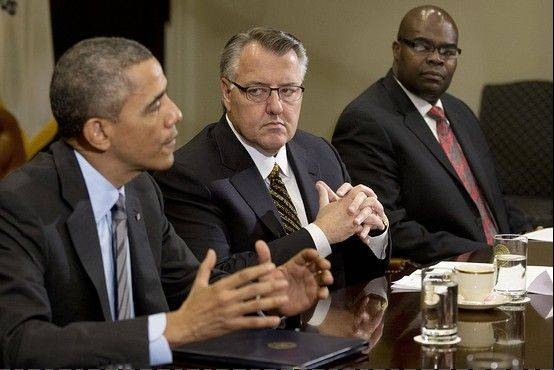 President Obama, at left, listens to CEOs from companies nationwide, including Schaumburg-based Motorola Solutions CEO Greg Brown, at center, during a meeting about immigration reform in Washington, D.C.