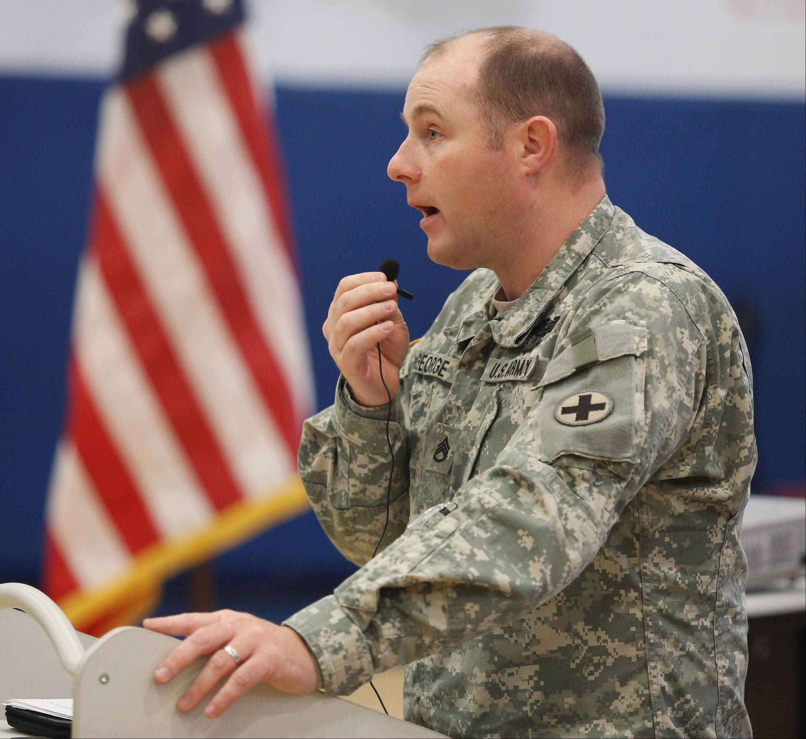 Army Staff Sgt. Patrick DeGeorge explains the history of Veterans Day during an assembly Monday at Frederick School in Grayslake.