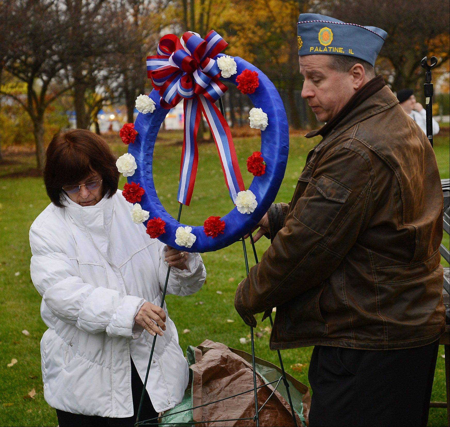 Women's Auxillary President Pat Kowalski and Jim Paschke of Palatine Post 690 place a wreath at the memorial during Palatine Veterans Day observance at Community Park.