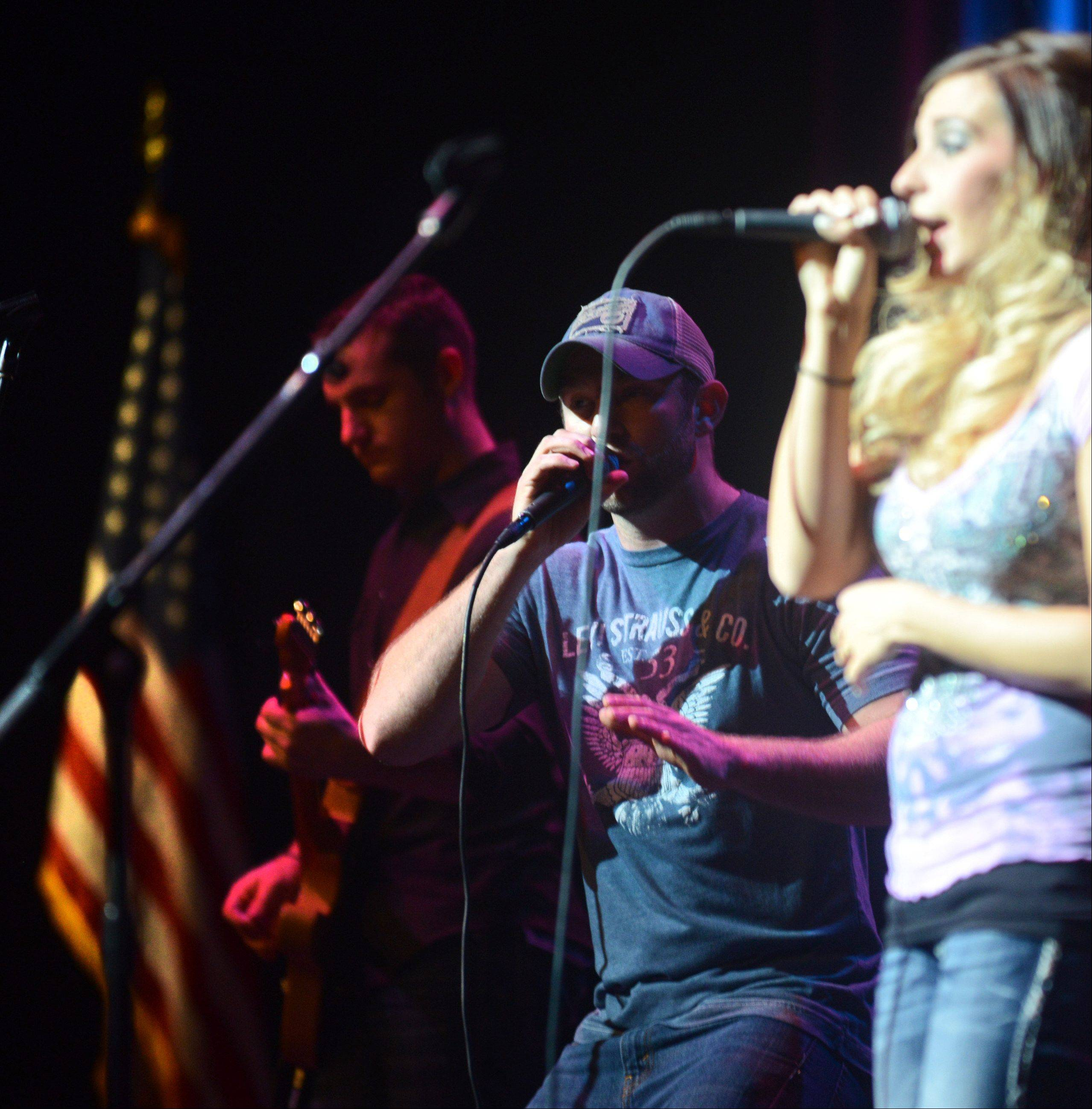 "Rosemont Theatre on Monday night hosted the Ramblin Ray's Salute to our Veterans. Here, the band ""Back Country Roads"" entertains the crowd."