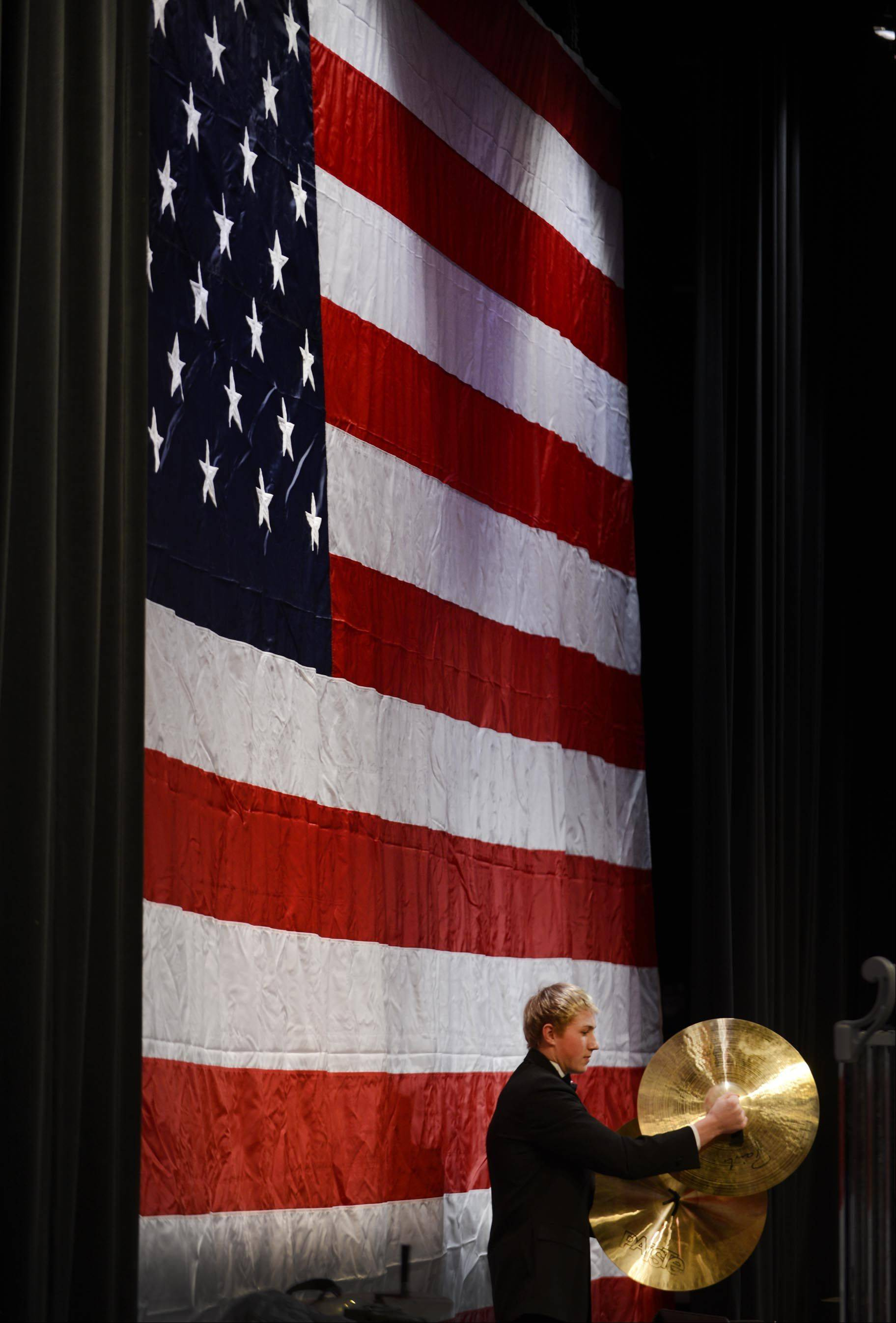 Percussionist Nathan Bawolek crashes the cymbals Monday at a Veterans Celebration Concert at St. Charles North High School. The school's student musicians played patriotic music during the program and veterans from every branch of the armed services were invited to stand as their theme song was played.