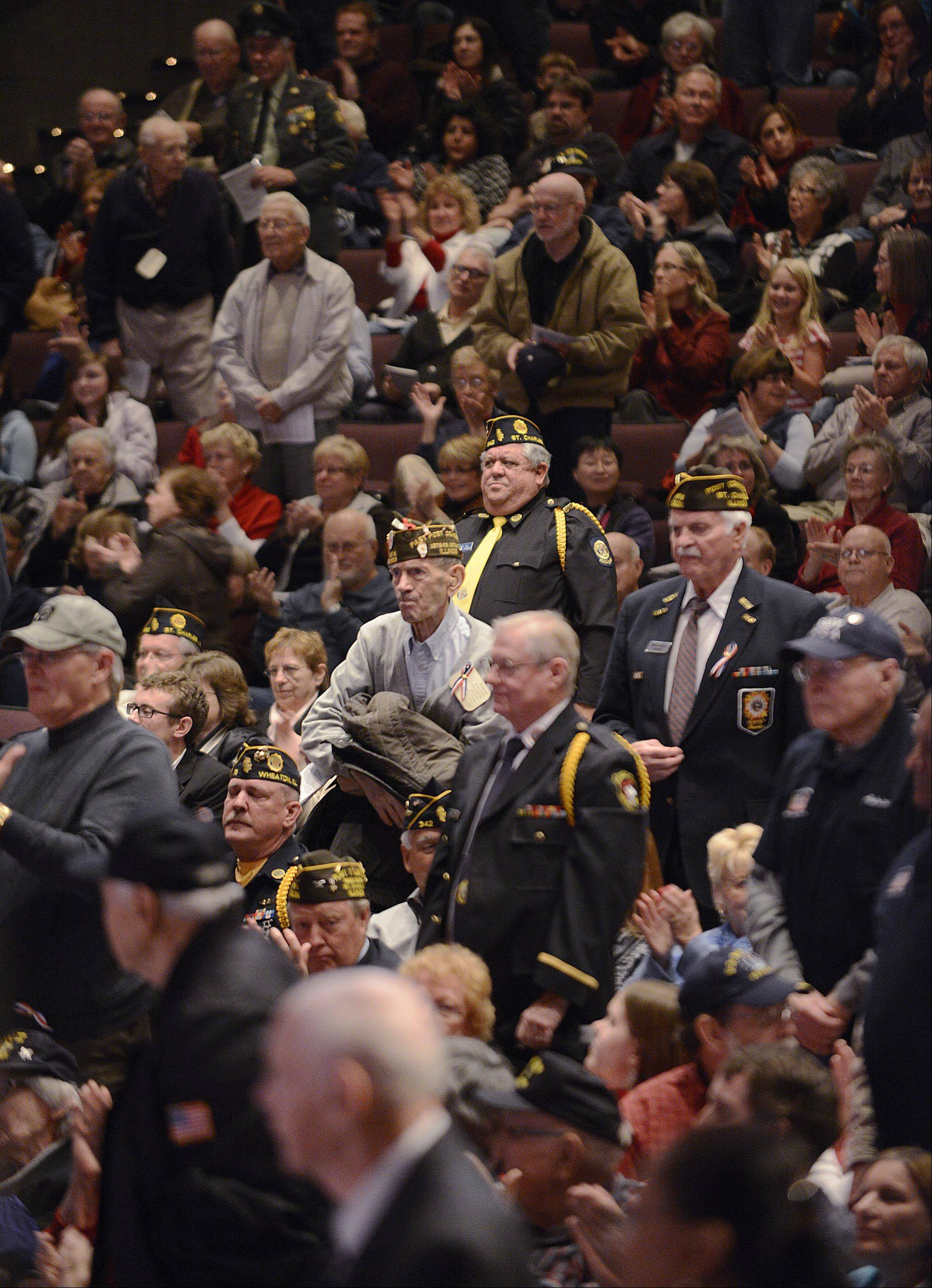 Veterans of each of the armed services were invited to stand as their theme song was played Monday at a Veterans Celebration Concert at St. Charles North High School. The school's student musicians played patriotic music during the program. More than 900 people attended.