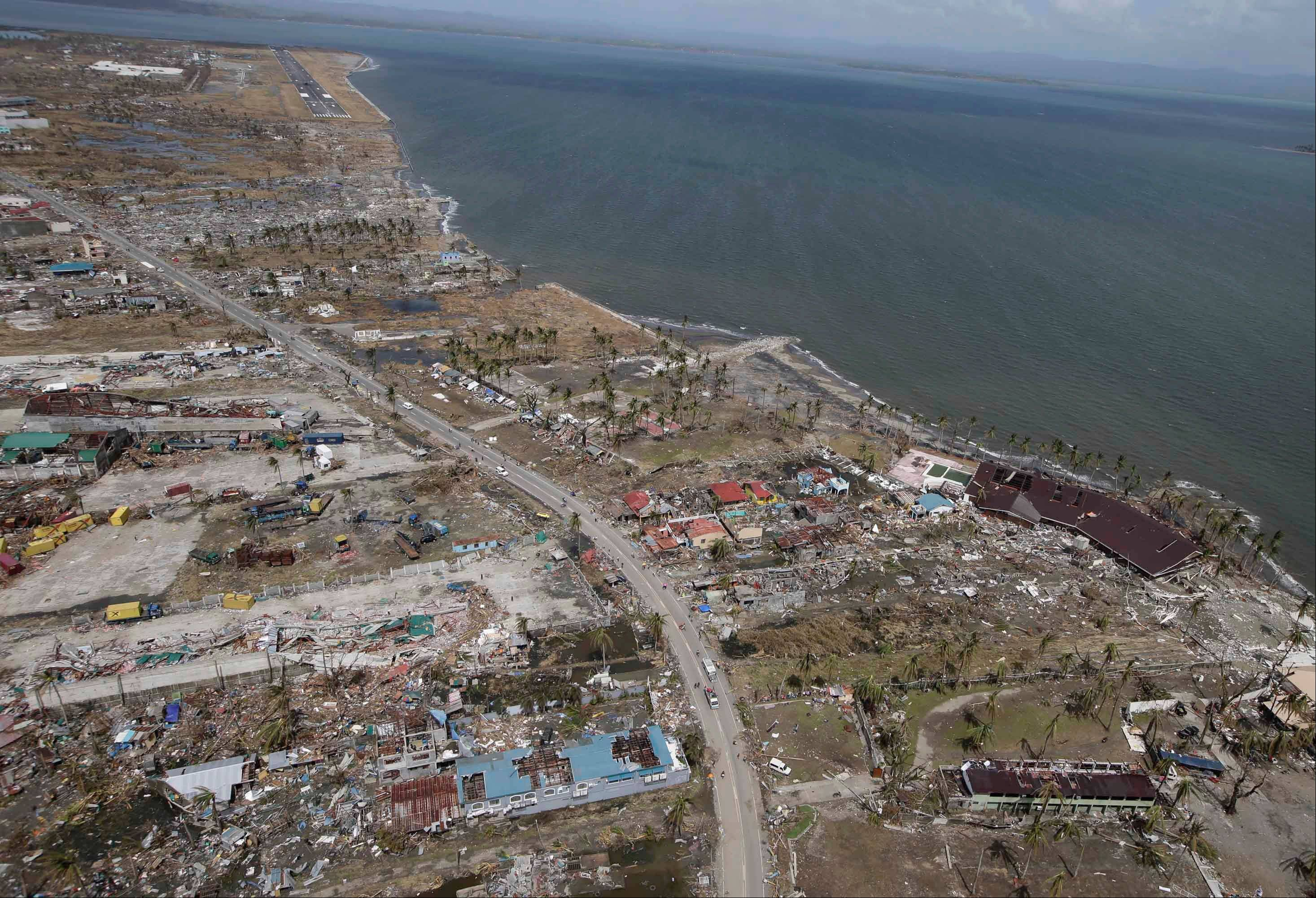 This aerial photo taken from a Philippine Air Force helicopter shows the devastation caused by Typhoon Haiyan in Tacloban city, Leyte province, central Philippines, Monday.