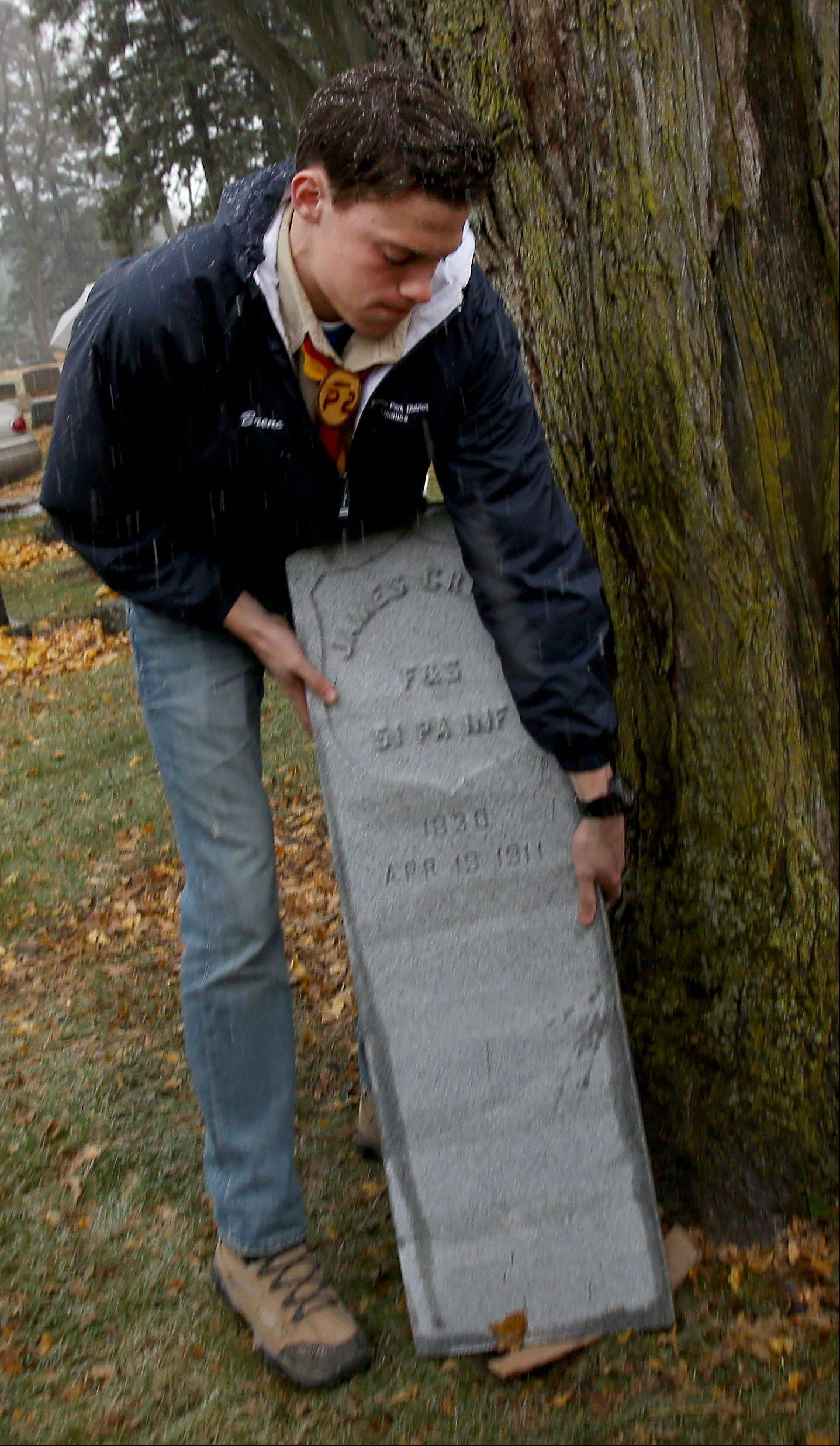 Boy Scout Josh Brenc with the tombstone of Civil War veteran James Cress. He plans to clean other headstones Saturday at Wheaton Cemetery.