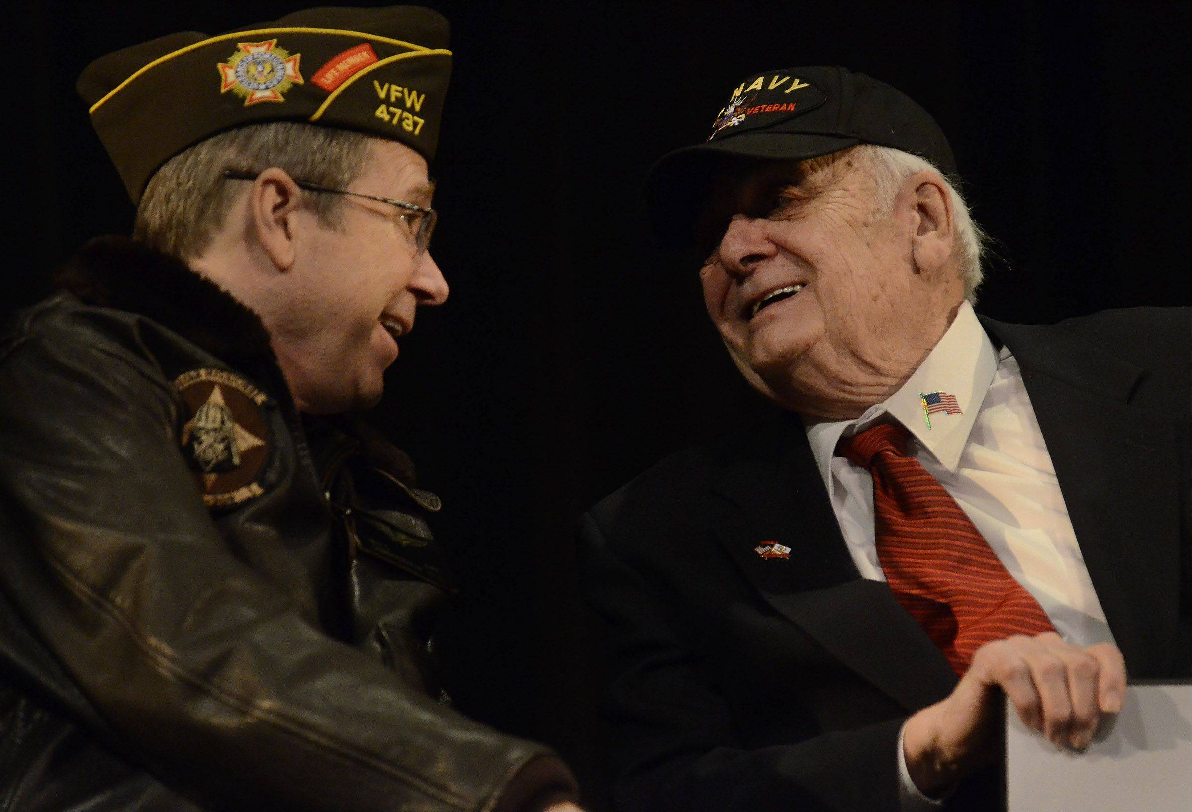 "U.S. Sen. Mark Kirk congratulates former U.S. Navy Radio Technician Second Class George Boesen of Arlington Heights on receiving the medals he earned for his service during World War II. Kirk told Boesen he earned the honors ""when you saved civilization."""