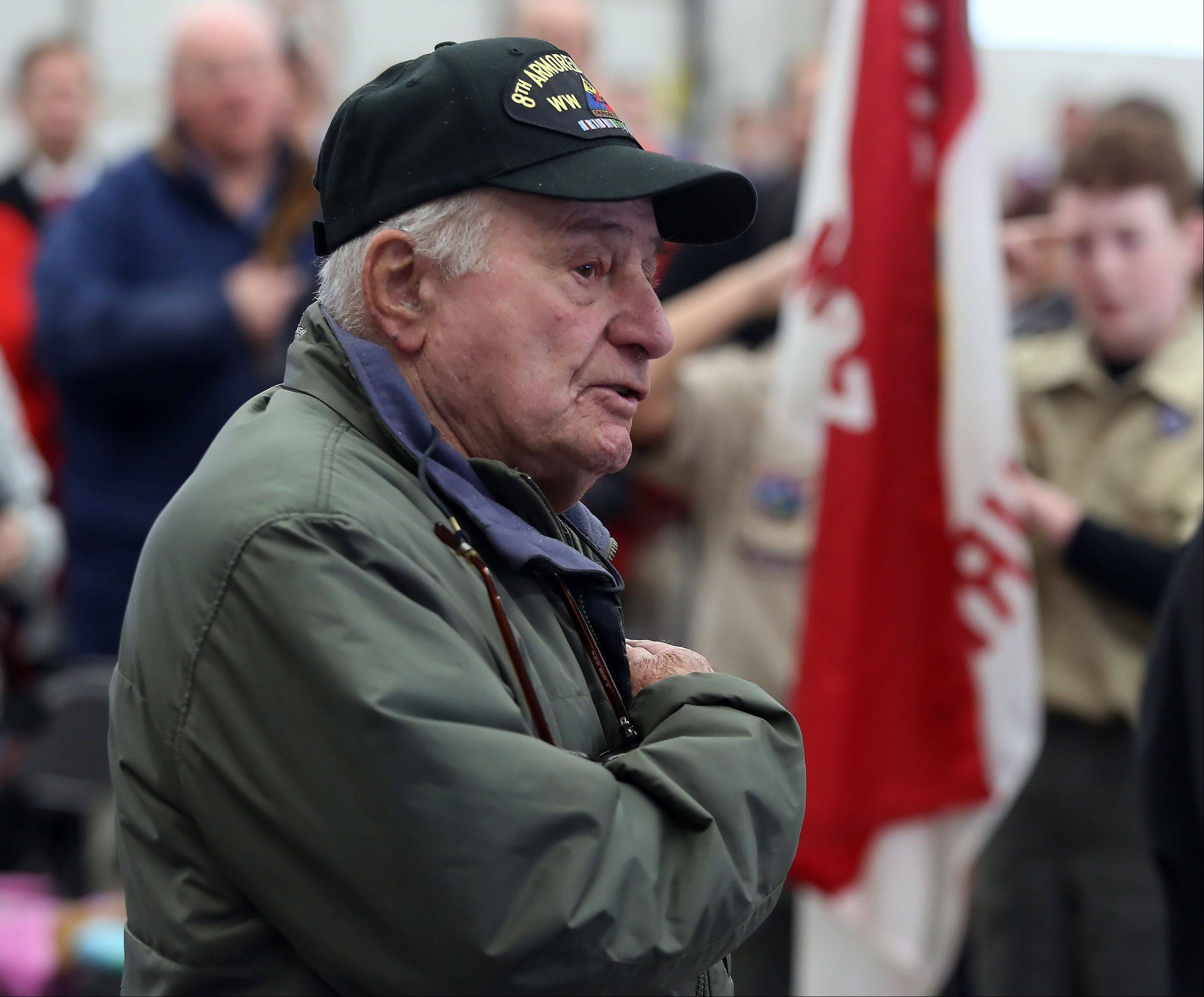 World War II veteran Morrie Dorfman of Lake Villa recites the Pledge of Allegiance during the Veterans Day ceremony Monday at the Lindenhurst Municipal Center and Veterans Memorial. The ceremony honored veterans and their families and featured several speakers, including Capt. R. Scott Laedlein, commanding officer of Navy Operational Support Command for Chicago.