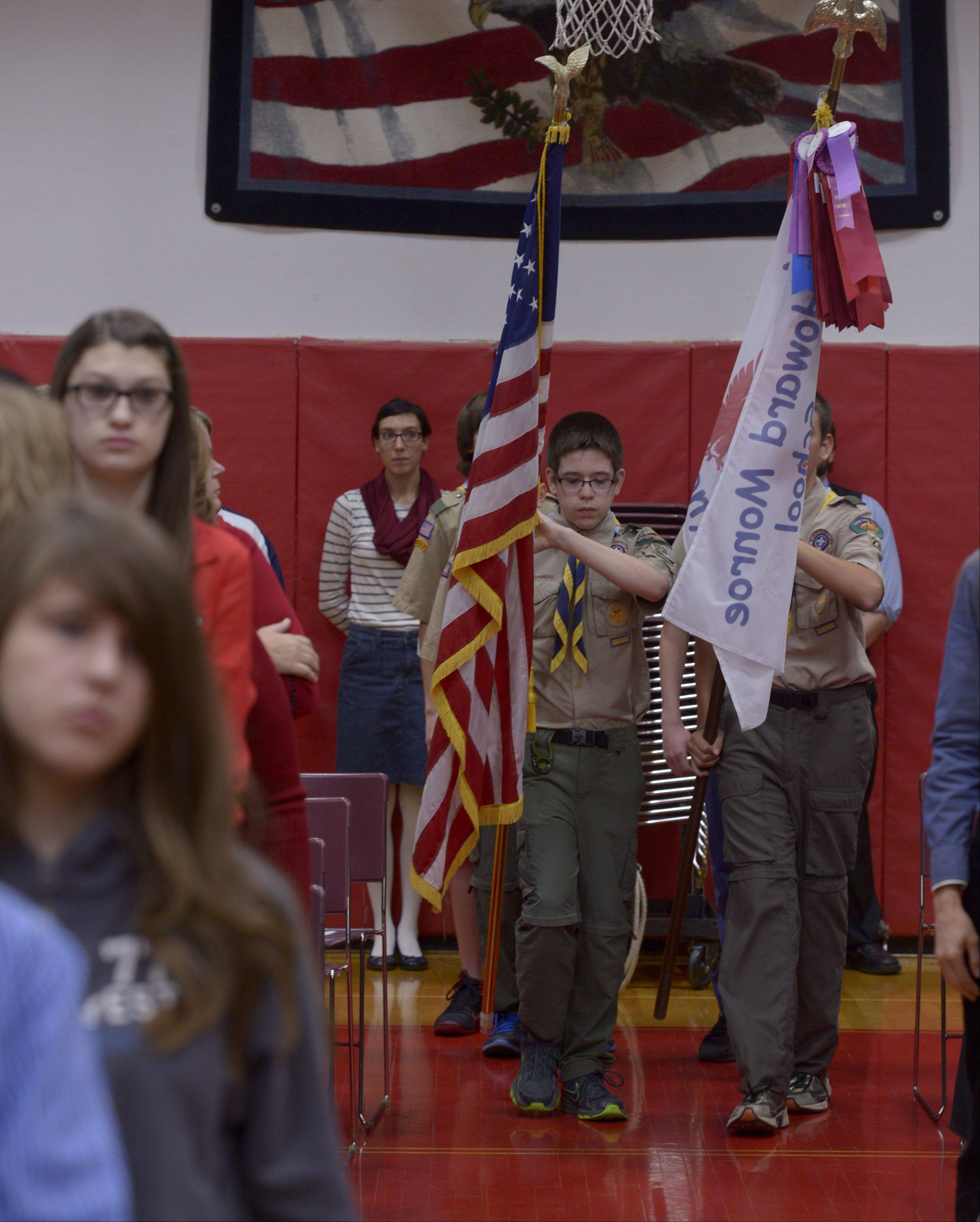 Members of Boy Scout Troop 23 present the flag during a Veterans Day Assembly Monday at Monroe Middle School.