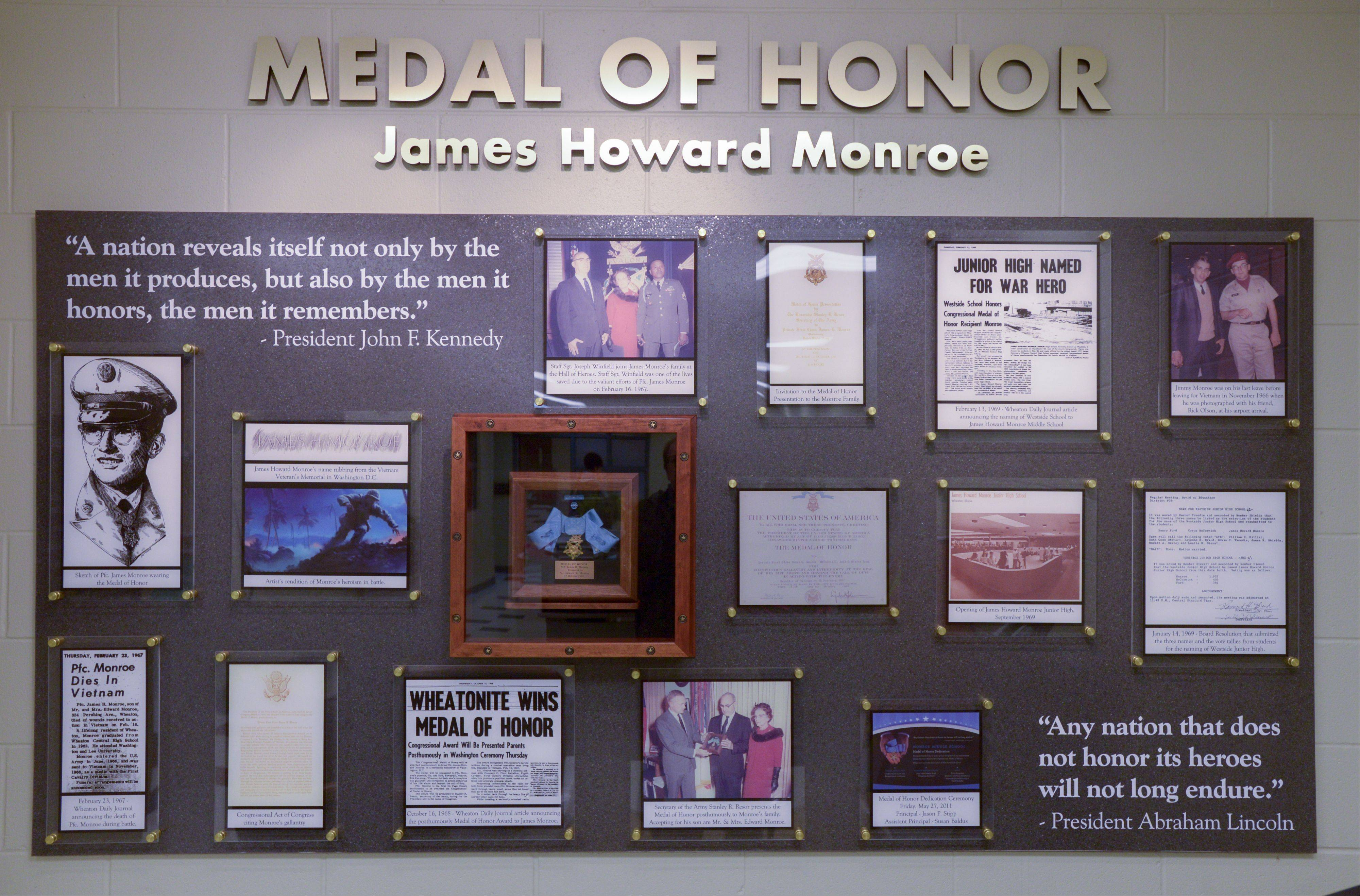 A wall in the school office of Monroe Middle School in Wheaton honors the school's namesake, Medal of Honor recipient James Howard Monroe of Wheaton. The display includes his medal.