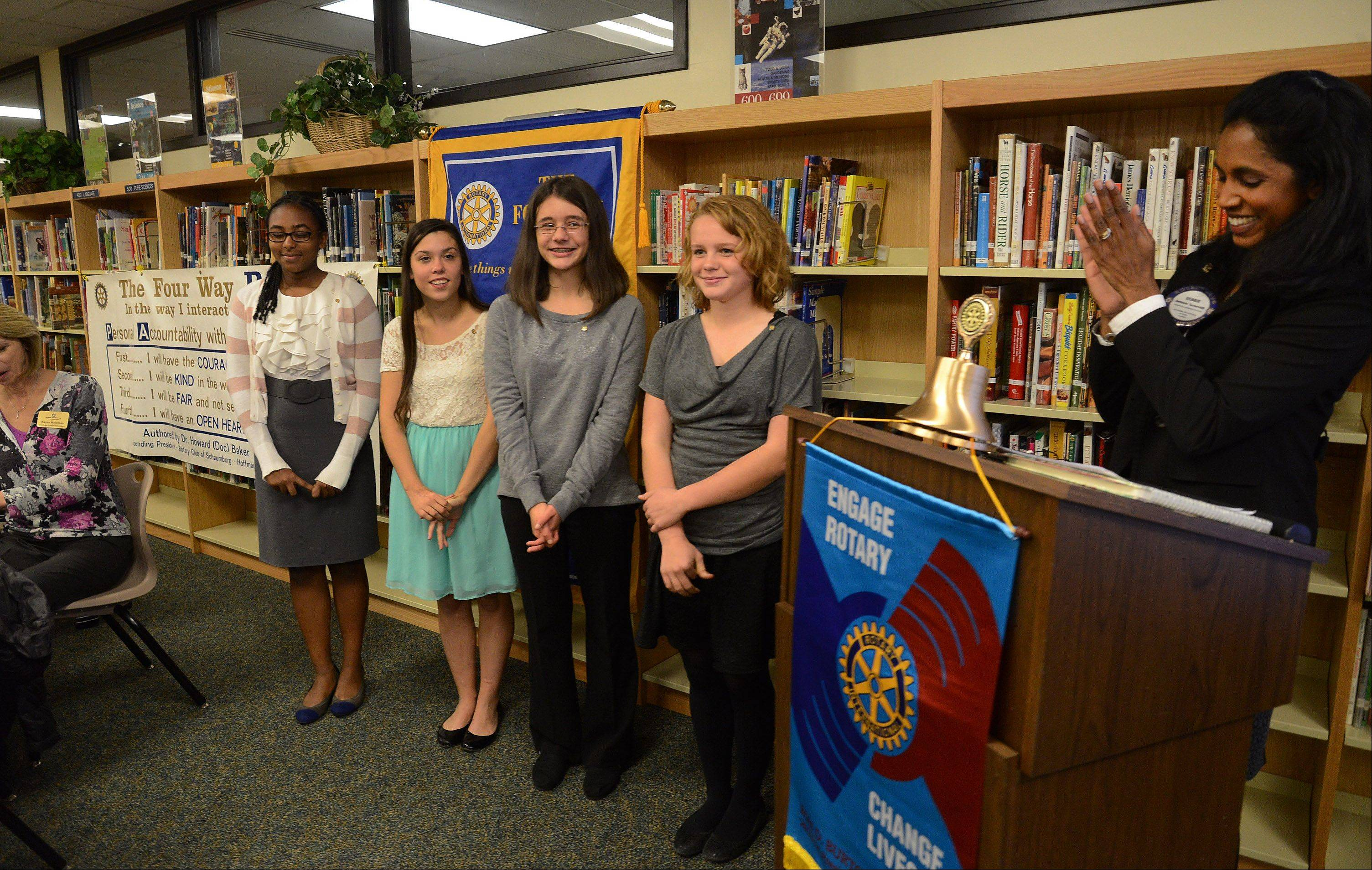 Keller Jr. High students from left, Keneni Godana, Morgan Krug, Allison Pariso and Amy Rodriguez are installed as Rotary members by Schaumburg/Hoffman Estates Rotary President Debbie Schmidt.