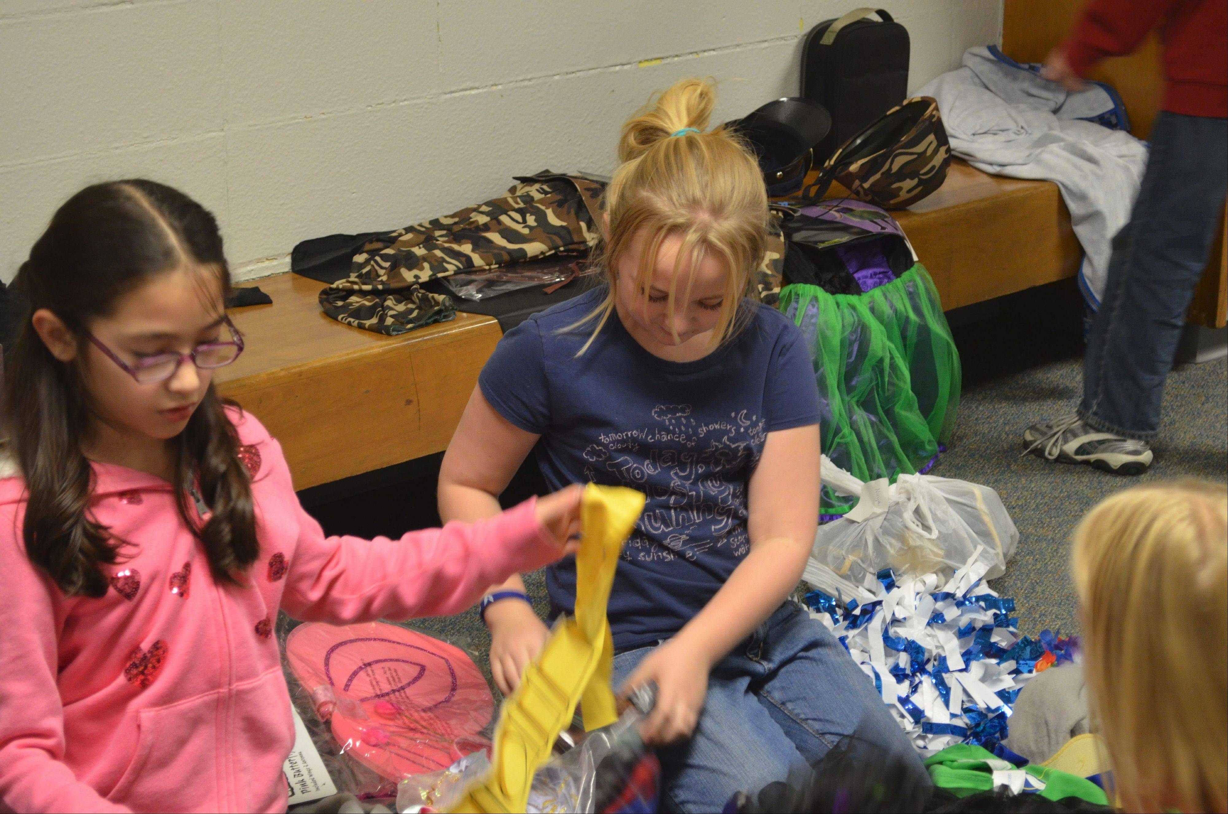 The Winston Campus Elementary Make a Difference club members sort through material to help provide Halloween costumes.