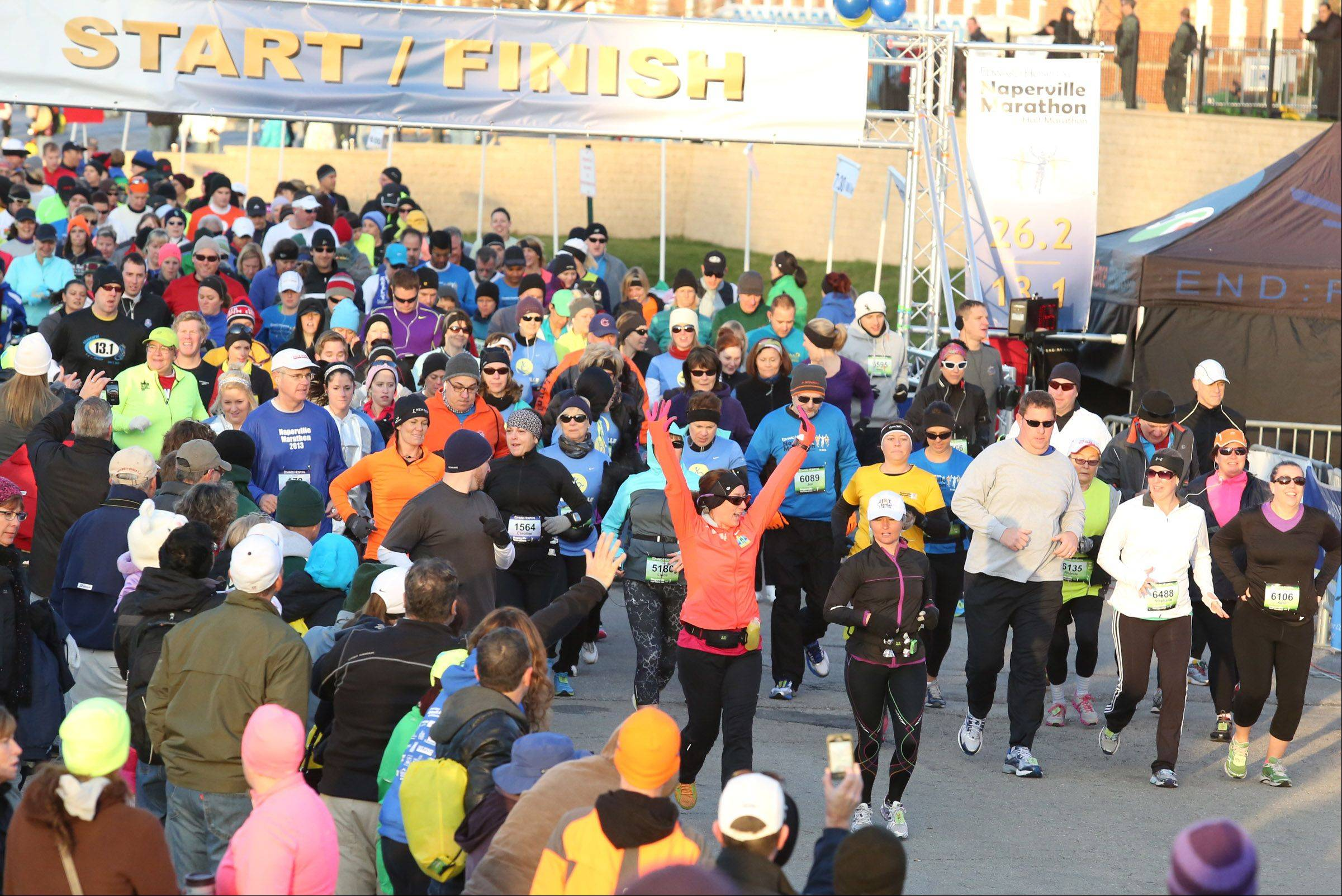 "A total of 2,562 runners participated in Sunday's inaugural Edward Hospital Marathon and Half Marathon. Organizers called the event a ""roaring success"" and said they'r"