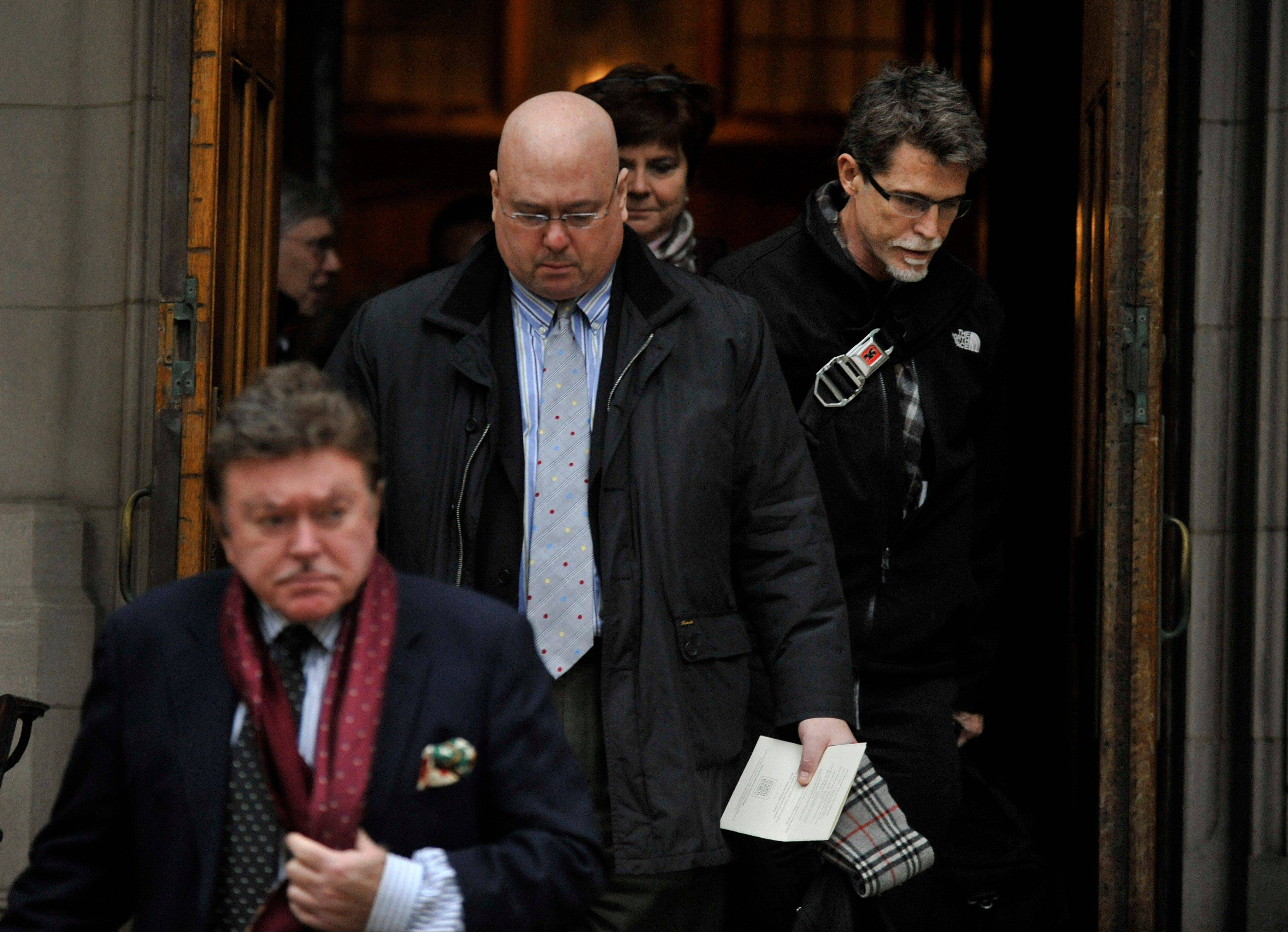 Chef Rick Bayless right, along with other mourners leave the Fourth Presbyterian Church after Monday's memorial for celebrity chef Charlie Trotter in Chicago. Trotter died last week at 54.