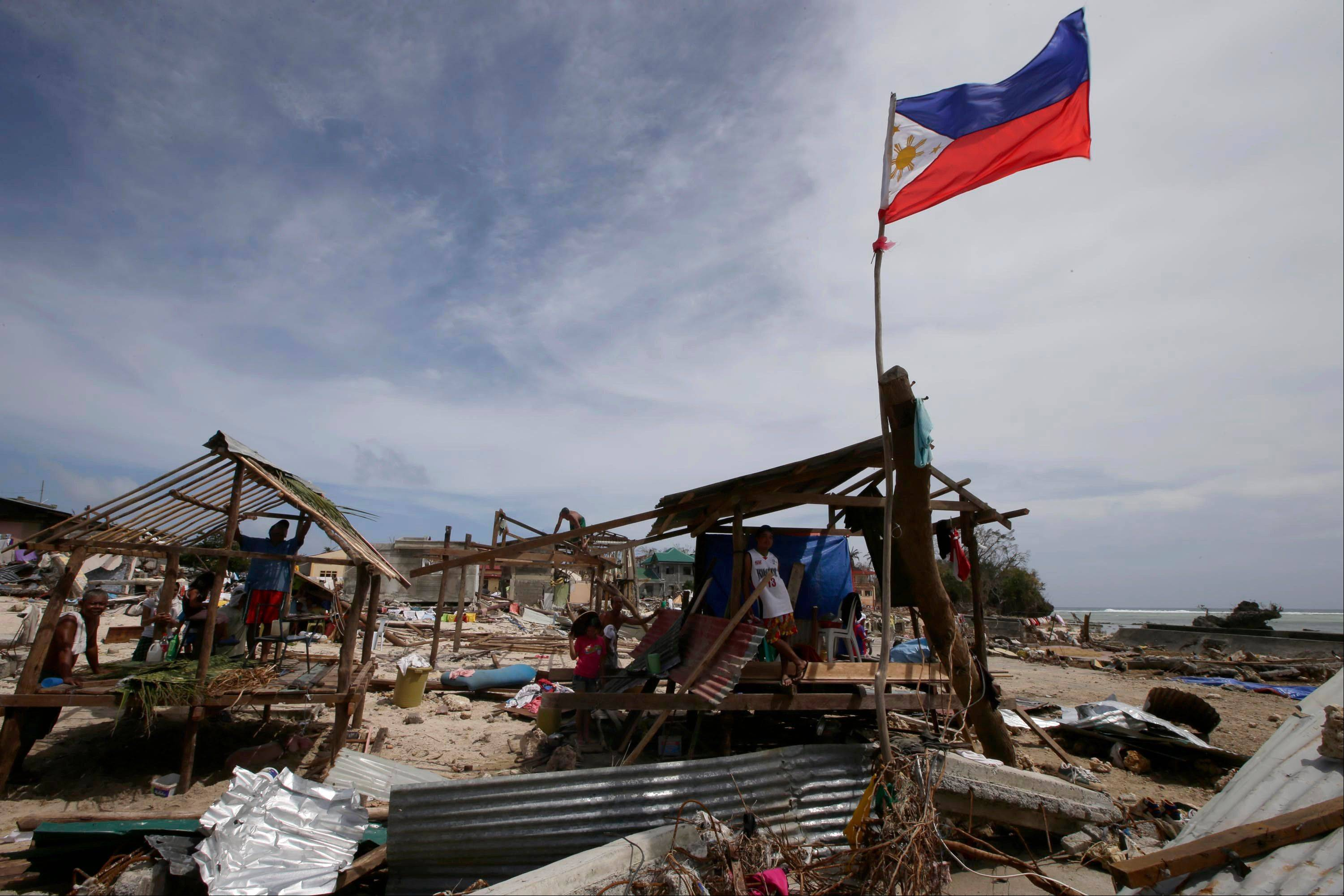 Residents rebuild their homes Monday following Friday's typhoon Haiyan that lashed Hernani township, Eastern Samar province, central Philippines.