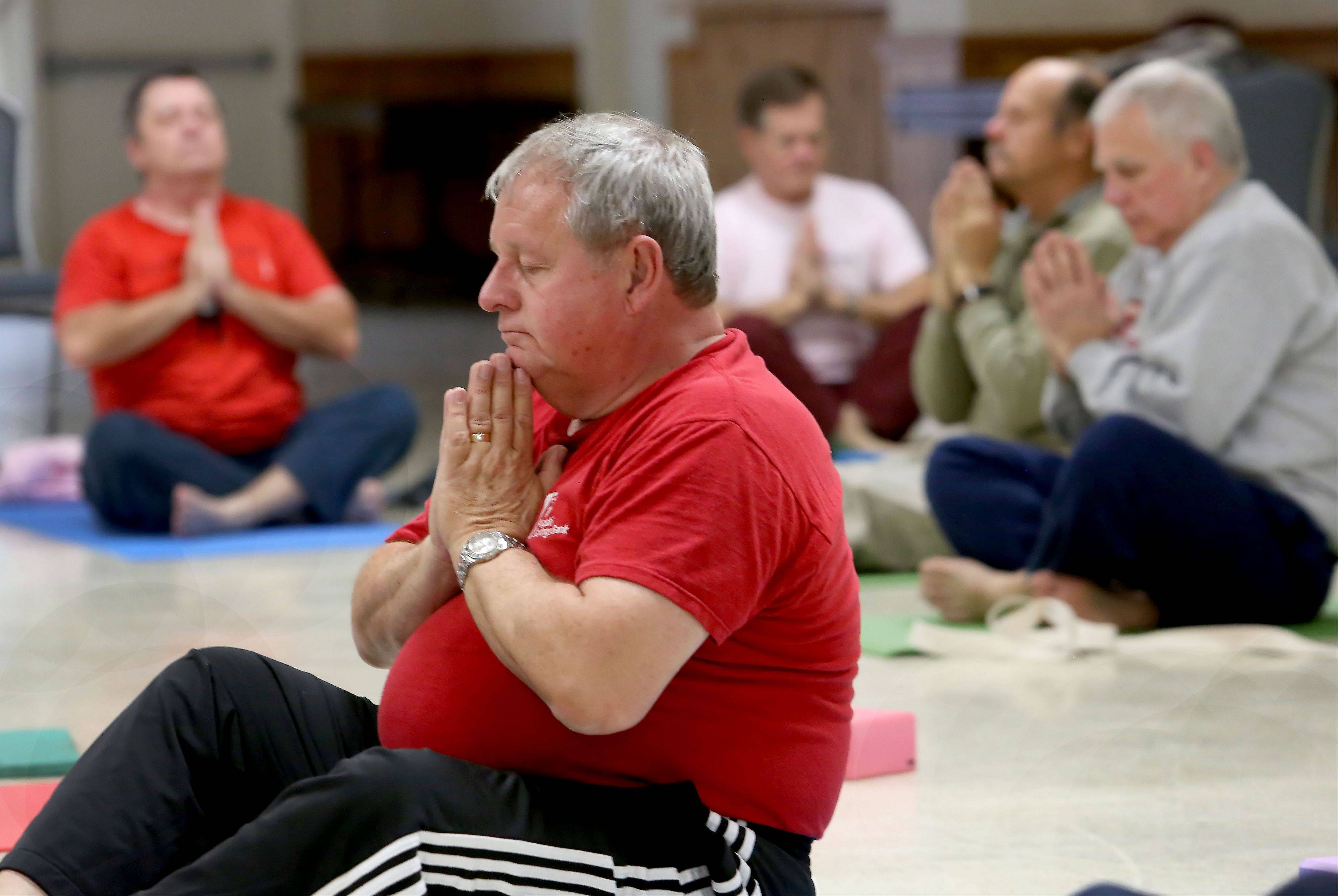 Roger Budny of Naperville relaxes during a yoga class for veterans at Judd Kendall VFW Post 3873 in Naperville. Volunteer instructor Dana Fish recently started offering yoga for veterans through Connected Warriors, a nonprofit organization that makes the physical and emotional benefits of yoga available to those who have served.