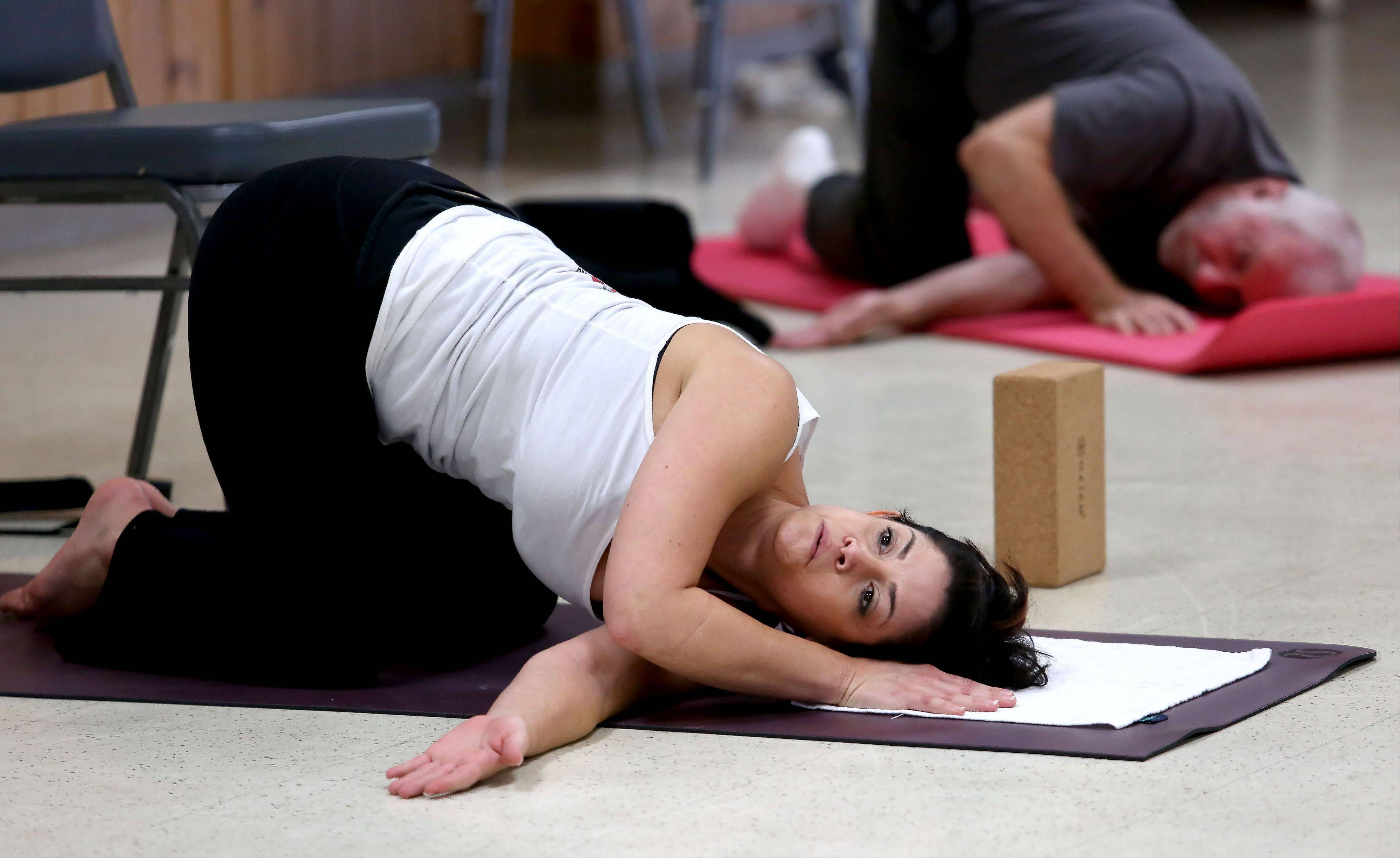 Dana Fish of Naperville teaches a yoga class at Judd Kendall VFW Post 3873 in Naperville. She recently started offering yoga classes for veterans through Connected Warriors, a Florida-based nonprofit that makes the physical and emotional benefits of yoga available to those who have served.