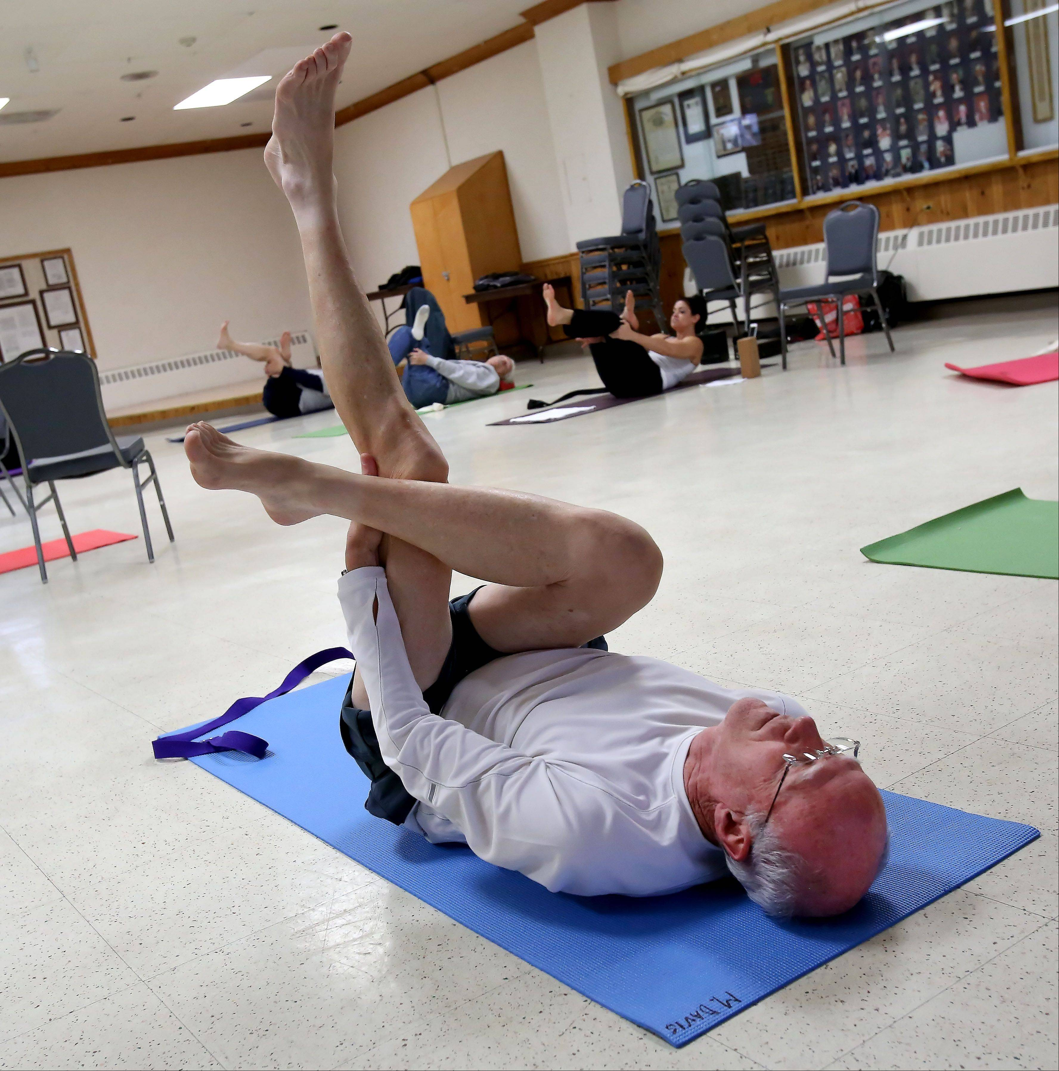 Mike Davis of Aurora holds a pose during a yoga class for veterans at Judd Kendall VFW Post 3873 in Naperville. About 20 veterans have participated in each free class, offered twice weekly since late October.