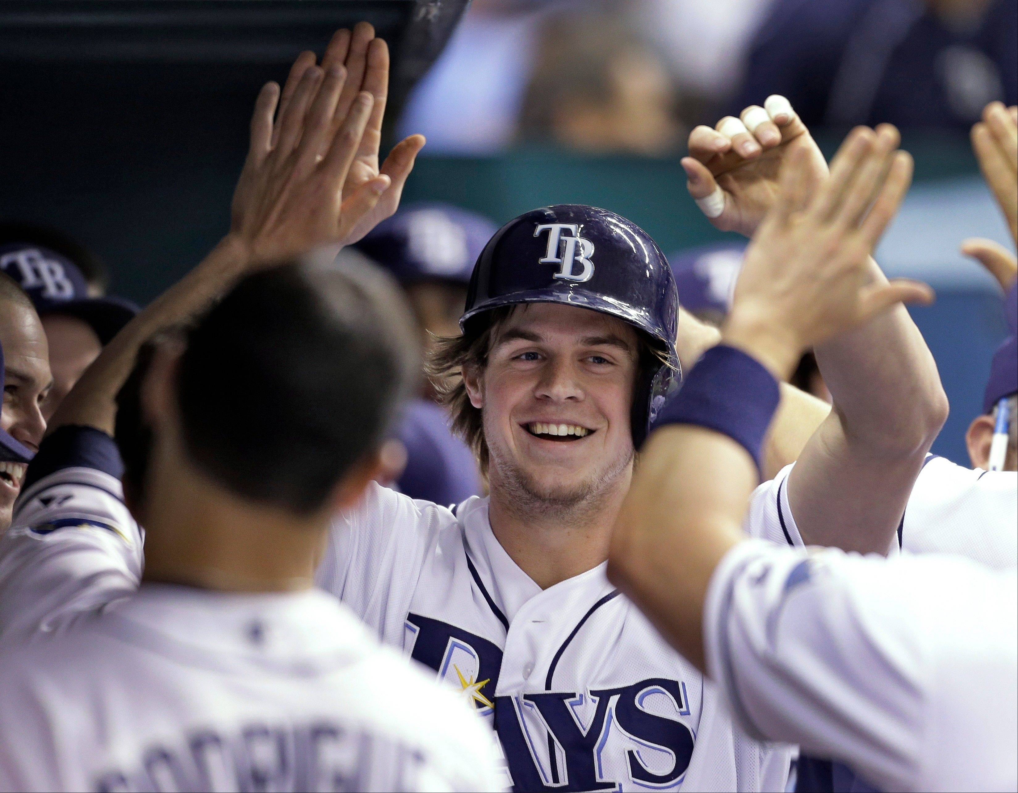 Tampa Bay's Wil Myers, center, received 23 of 30 first-place votes for AL Rookie of the Year.