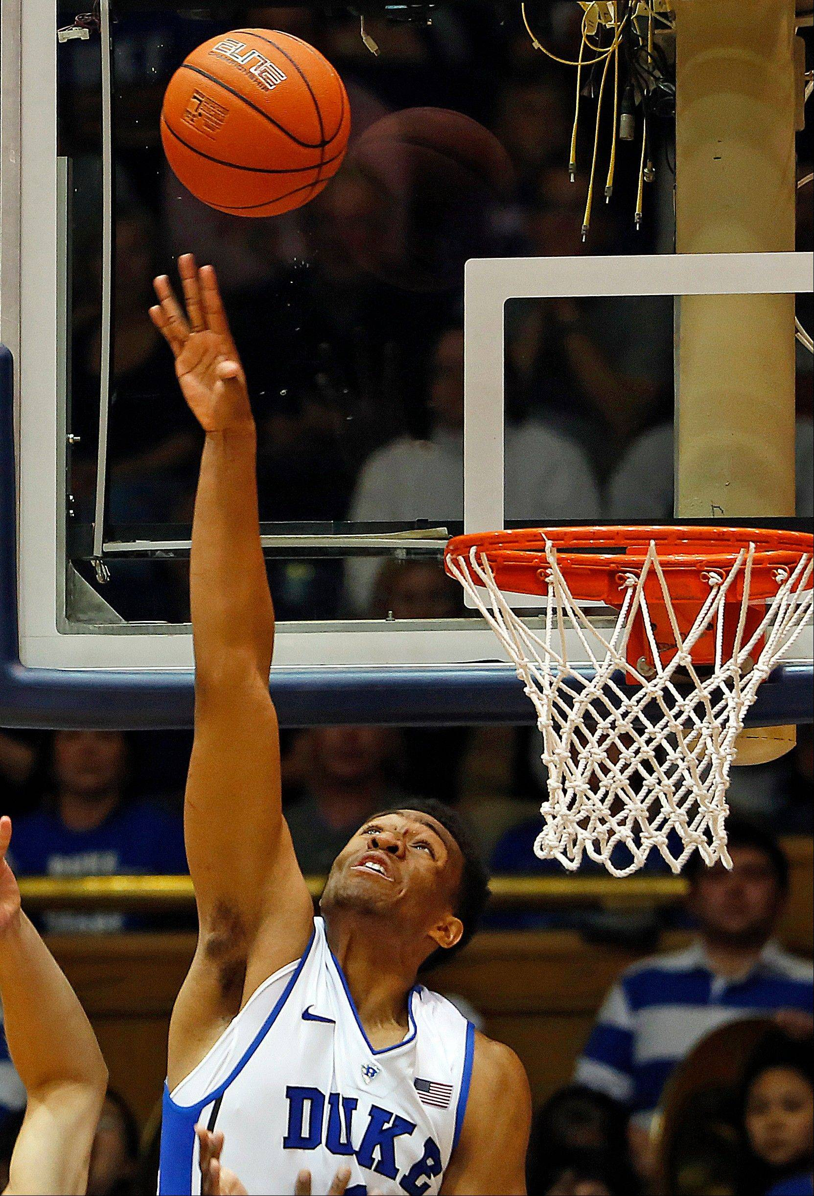 Duke's Jabari Parker blocks a shot during the second half of Friday's game against Davidson in Durham, N.C. Duke won 111-77.