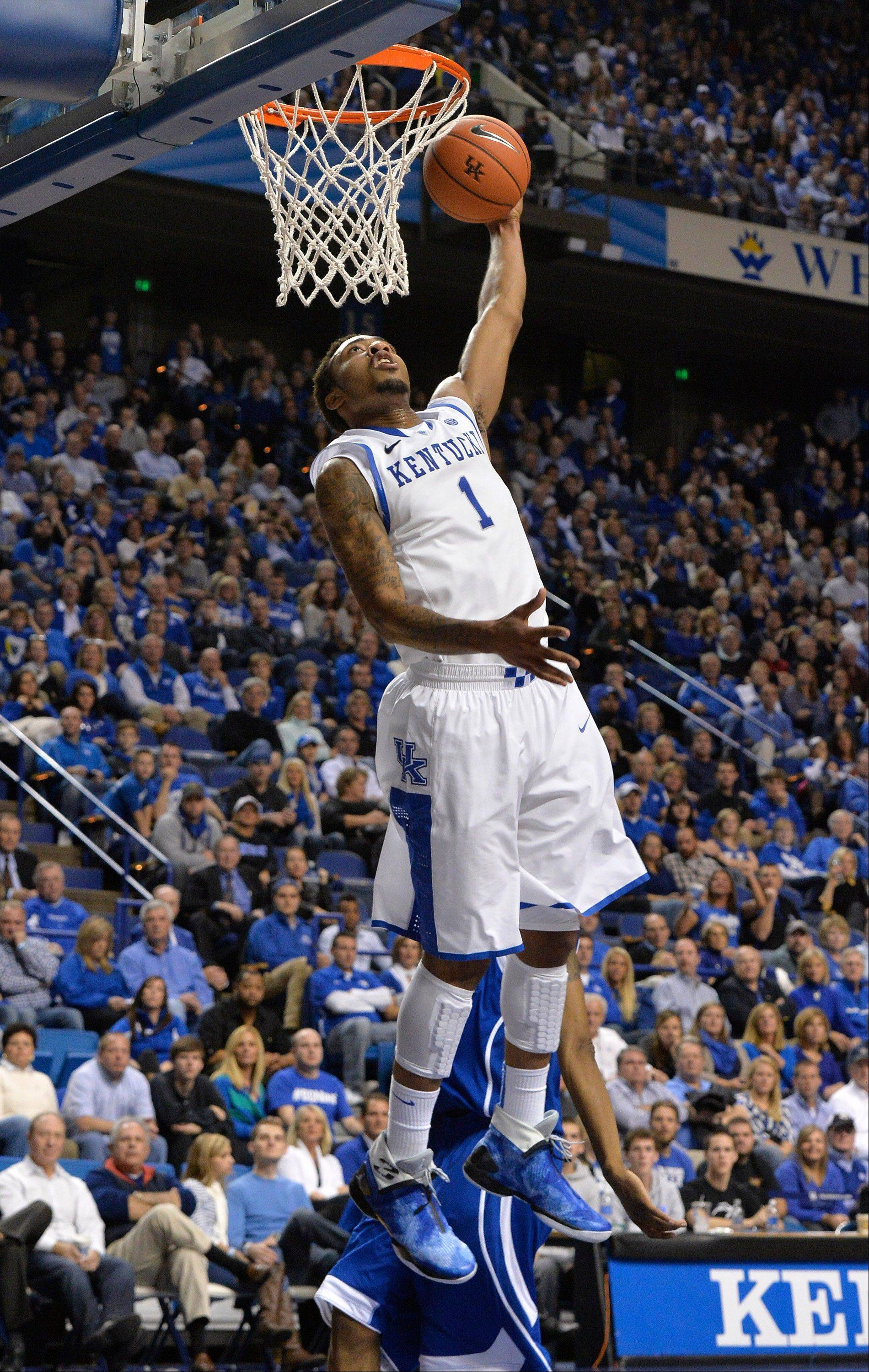 Kentucky's James Young goes up for a dunk during the second half of Friday's game against UNC Asheville in Lexington, Ky. Kentucky defeated UNC Asheville 89-57.