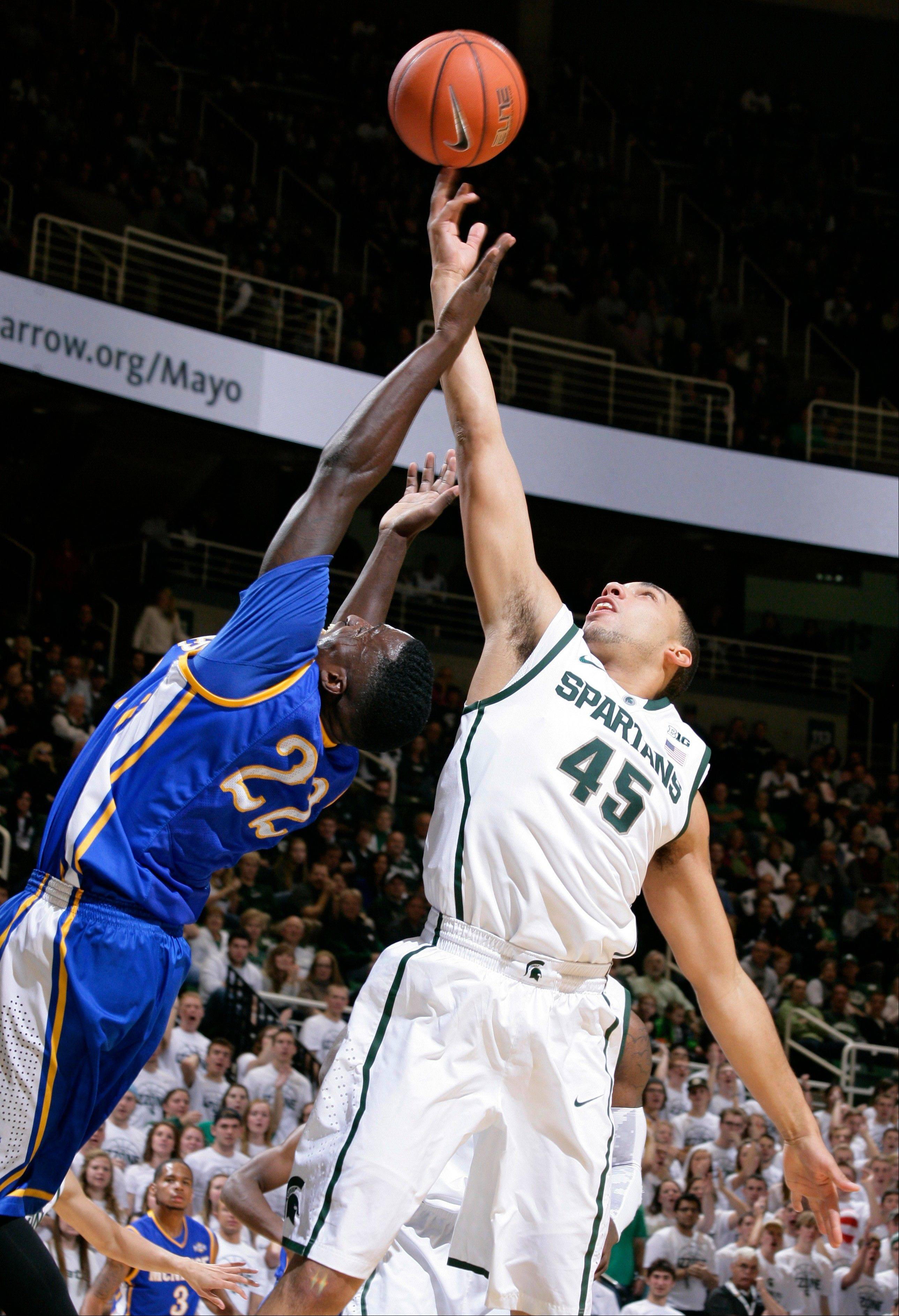 Michigan State's Denzel Valentine and McNeese State's Ledrick Eackles (reach for a rebound during the first half of Friday's game, in East Lansing, Mich. The No. 2 Spartans play top-ranked Kentucky on Tuesday.