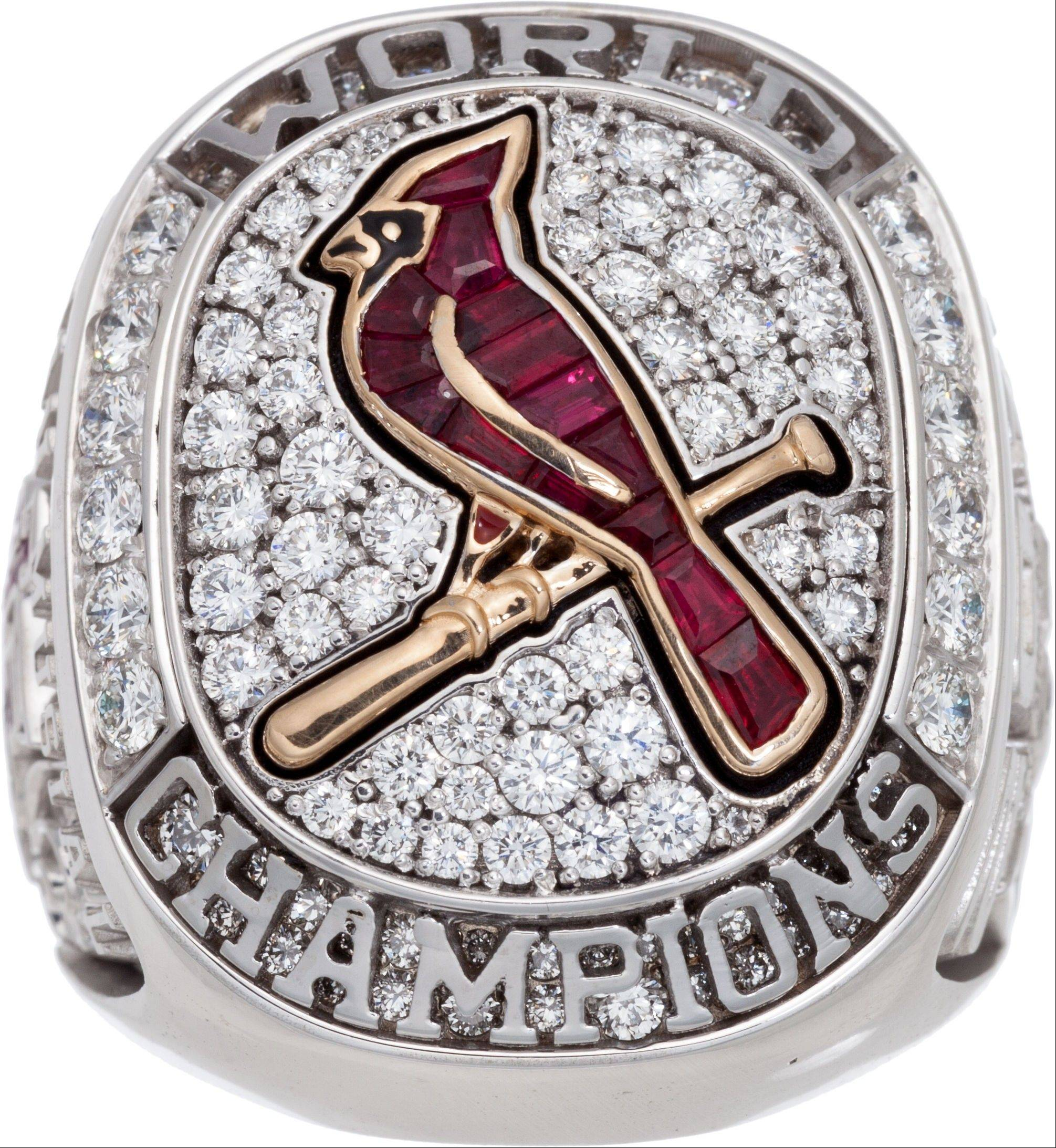 Stan Musial's 2011 St. Louis Cardinals World Championship ring sold for $191,200 at auction. His family kept most of his belongings, but grandson Brian Schwarze said Musial's four-bedroom Ladue home was stuffed with so many things he'd collected over the years that relatives decided on an auction.