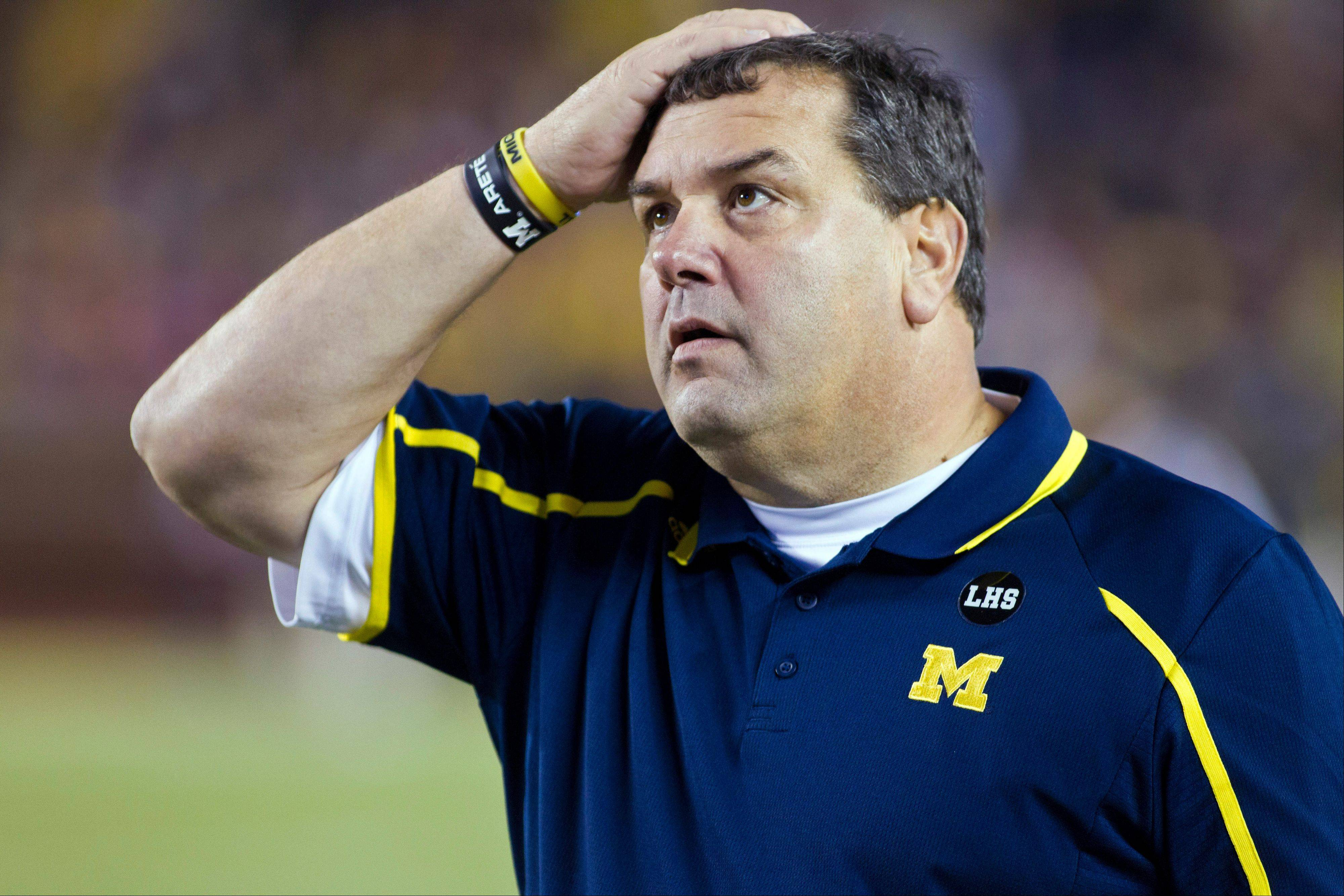 Michigan head coach Brady Hoke looks up at the scoreboard during the fourth quarter of Saturday's loss to Nebraska in Ann Arbor, Mich.