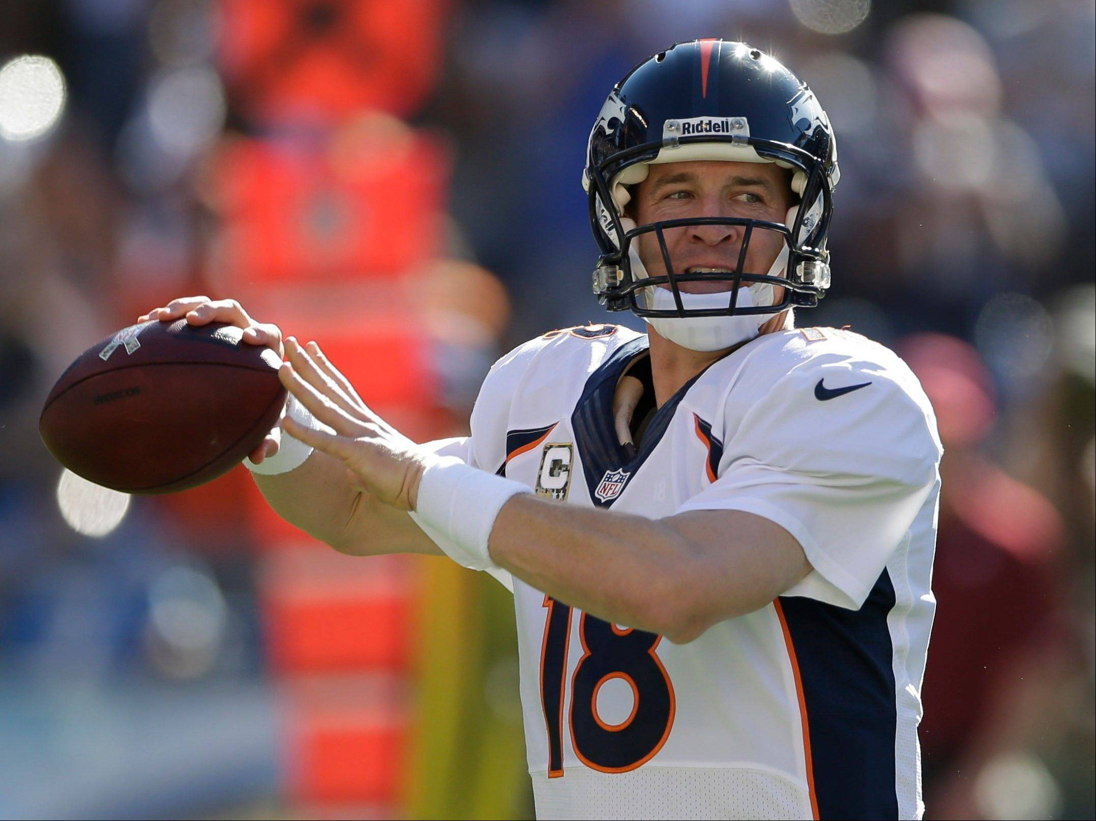 Denver Broncos quarterback Peyton Manning throws a pass Sunday during the second half against the San Diego Chargers in San Diego.