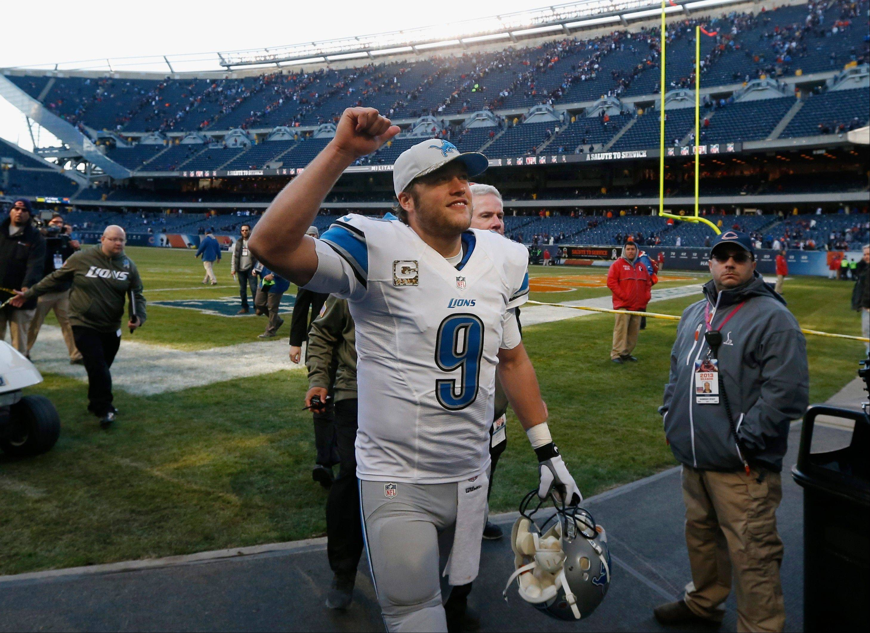 Detroit Lions quarterback Matthew Stafford celebrates Sunday as he walks off the field after the Lions' 21-19 win over the Bears at Soldier Field.