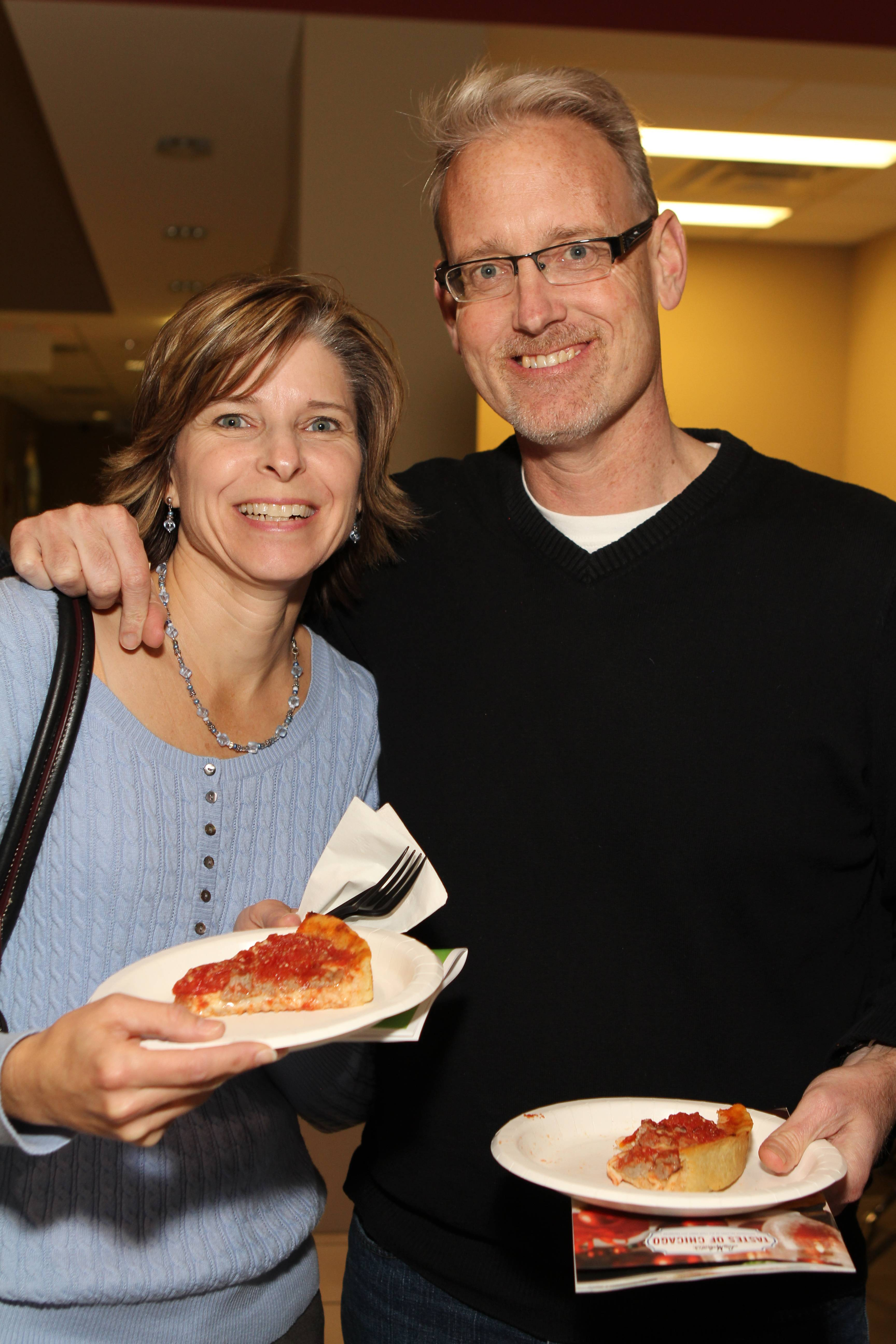 Tim and Susan Campbell of Rolling Meadows sample slices of Lou Malnati's famous deep-dish pizza at the 5th annual Clearbrook Around the World Food Tasting.