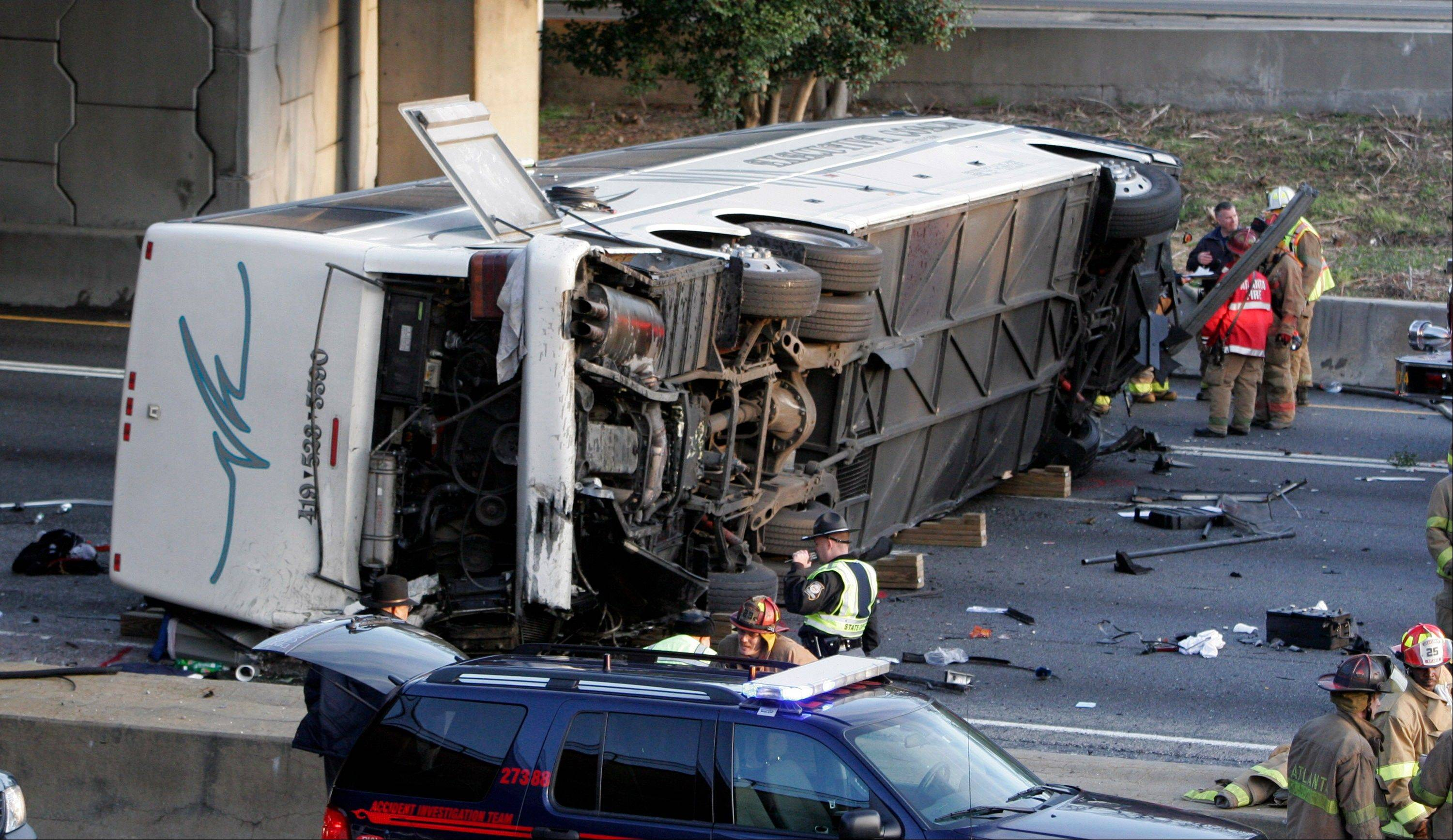 This March 2, 2007, file photo shows a charter bus carrying the Bluffton University baseball team from Ohio after it plunged off a highway ramp in Atlanta and slammed into the I-75 pavement below. Five players, the bus driver and his wife were killed. Twenty-eight others were injured.