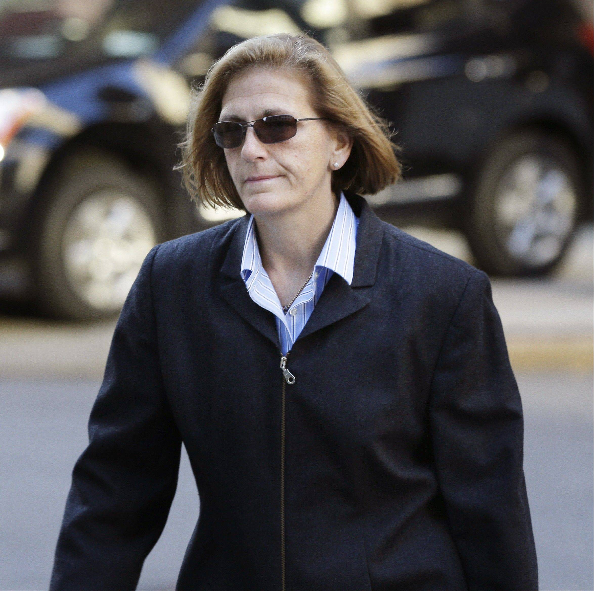 WisconsinJoAnn Crupi, right, arrives at federal court in New York, Tuesday, Oct. 8, 2013. Prosecutors say fictitious trades and phantom accounts were created with help from Crupi, an account manager. (