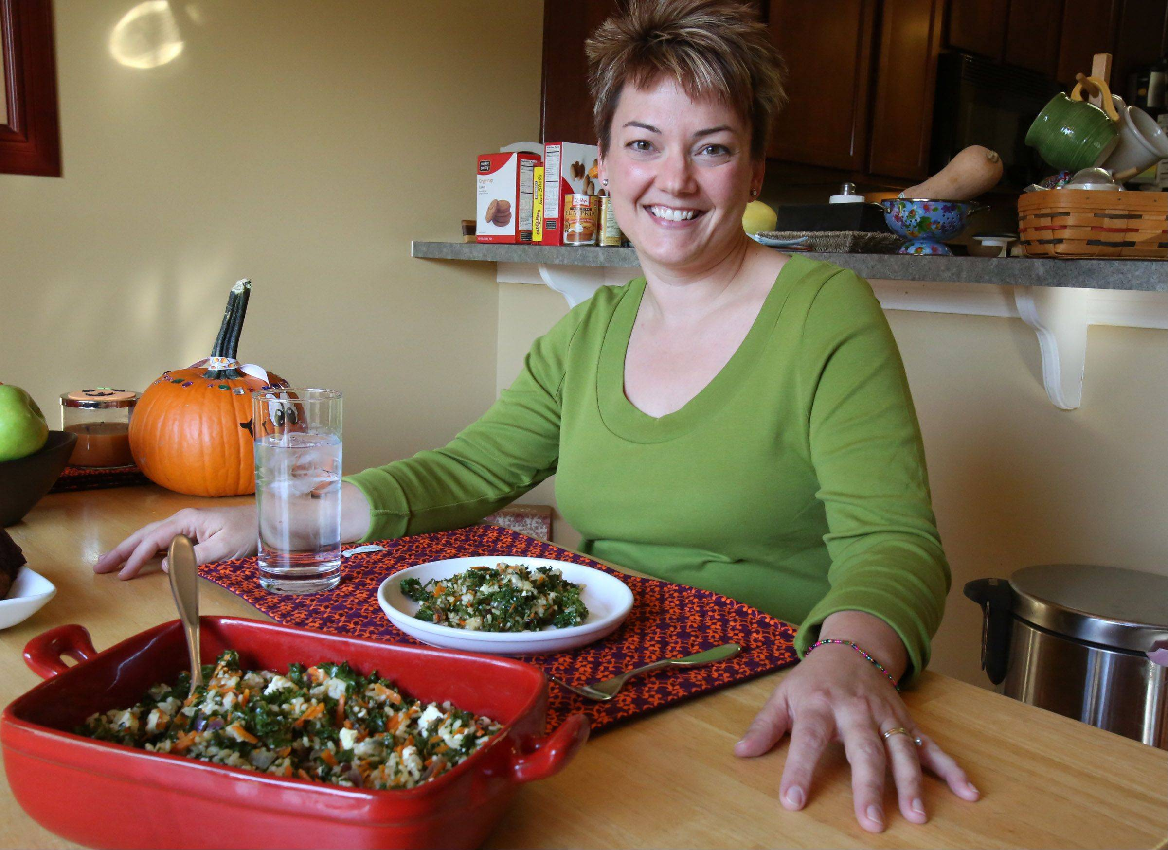 Christine Gallup builds dinner around nutrient-rich recipes like Sauteed Kale Rice, so her family can enjoy treats like her Double Cookie Brownies.