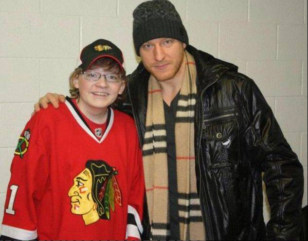 Larkin High School graduate Greg White, who is awaiting a double-lung transplant, poses with Chicago Blackhawks forward Marian Hossa. White�s family and friends have raised more than $50,000, out of an overall goal of $70,000, for his transplant operation.
