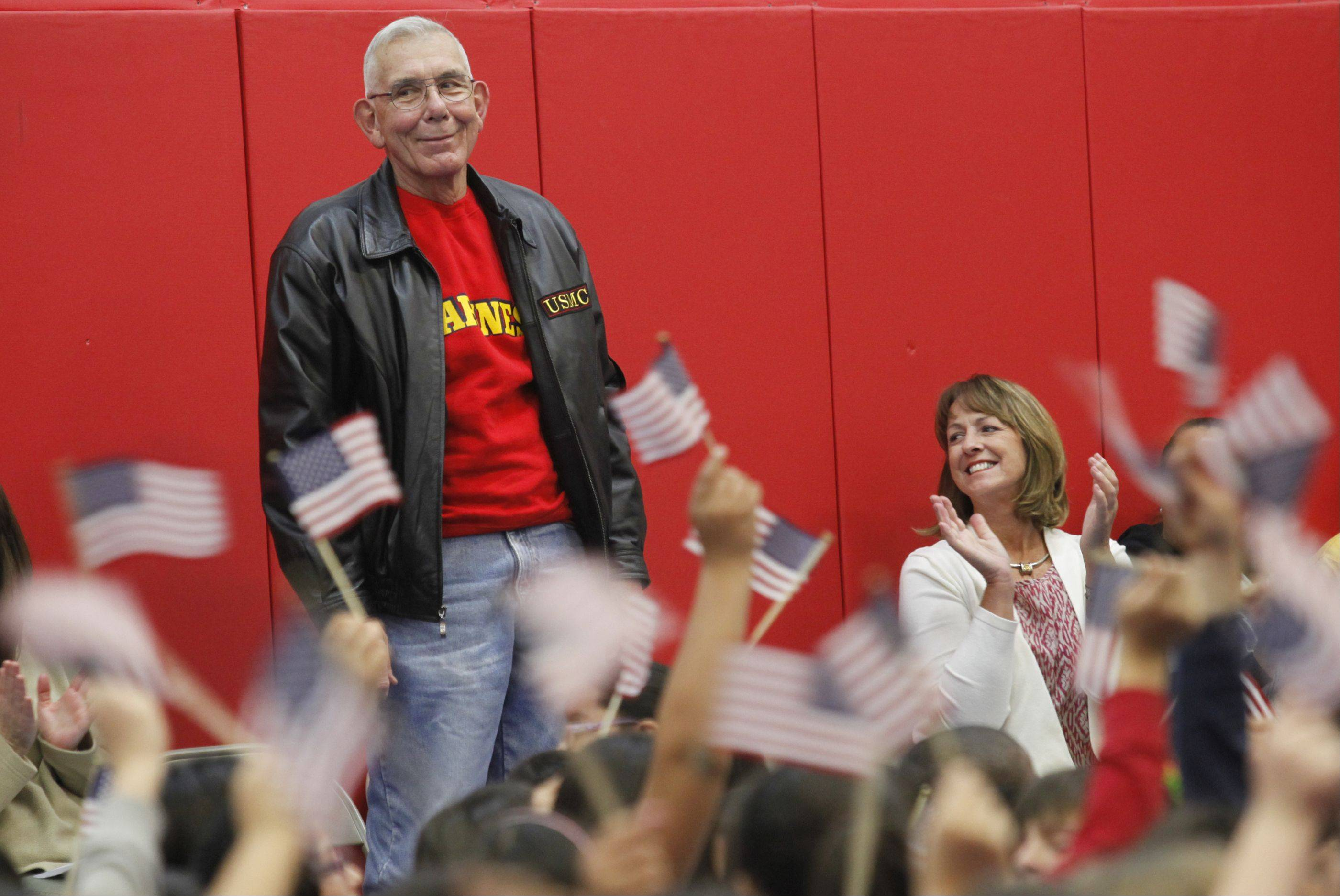 Marine Corps veteran Alfred Laseke stands to be recognized during the Veterans Day ceremony Monday at Parkview Elementary in Carpentersville. Laseke, who lives in Rockford, visited Parkview since his grandson, Tommy Schnackel, is a third-grader at the school.
