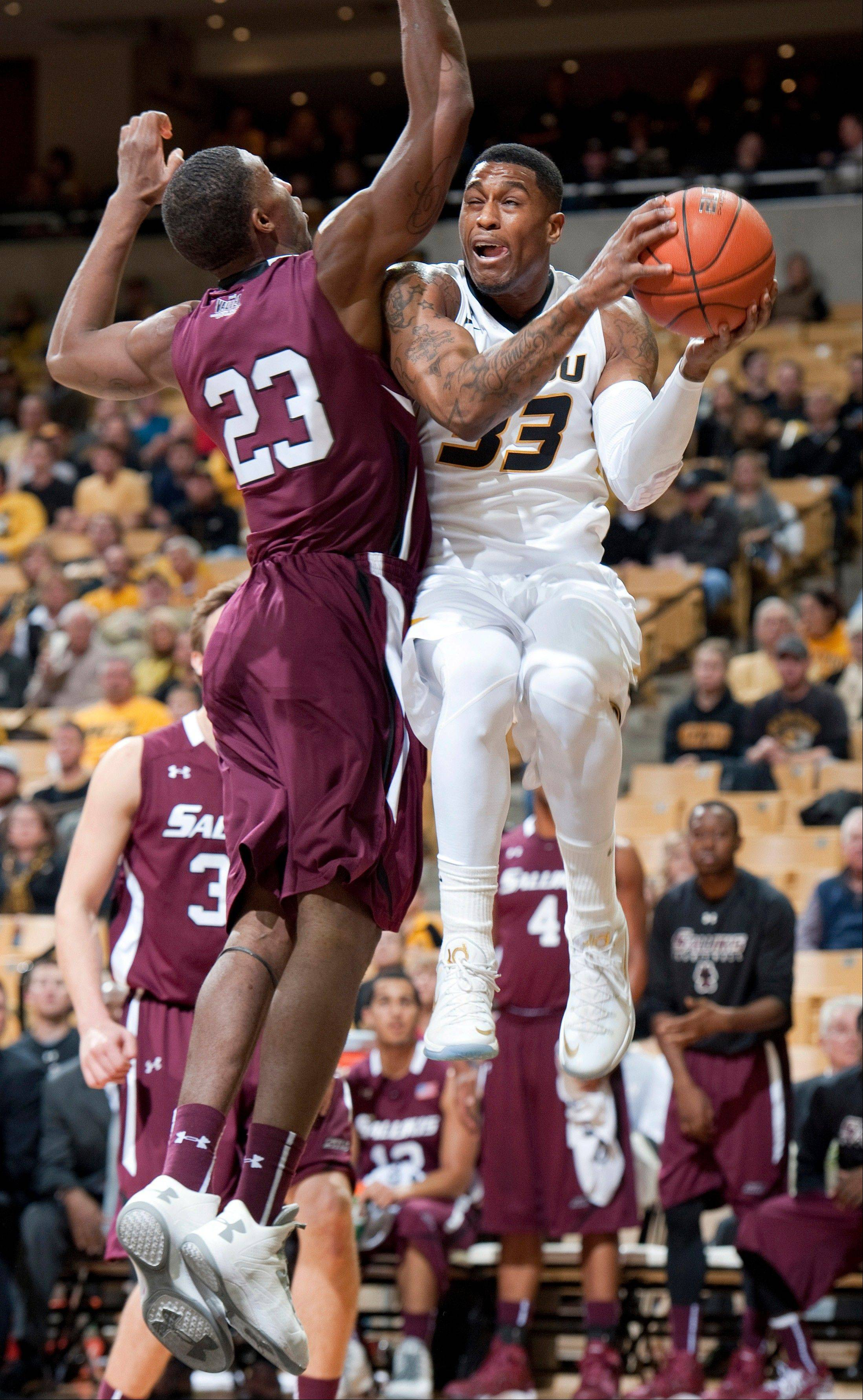 Missouri�s Earnest Ross, right, is fouled by Southern Illinois� Bola Olaniyan as he shoots during the first half of Tuesday�s game in Columbia, Mo.