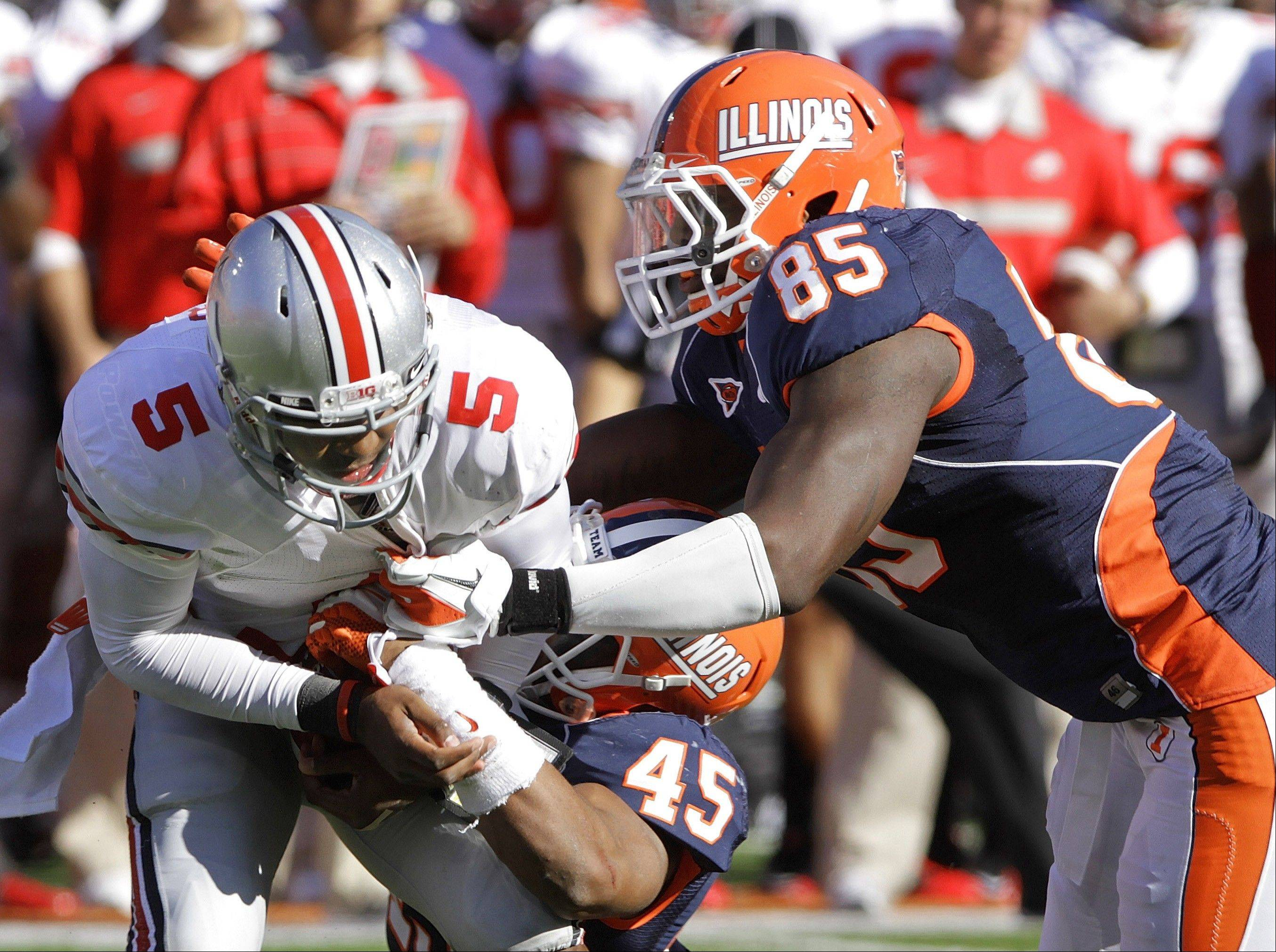Illinois defensive end Whitney Mercilus (85) and linebacker Jonathan Brown (45) combine to sack Ohio State quarterback Braxton Miller during the 2011 game. Ohio State attempted just four passes � completing one � in a 17-7 victory.