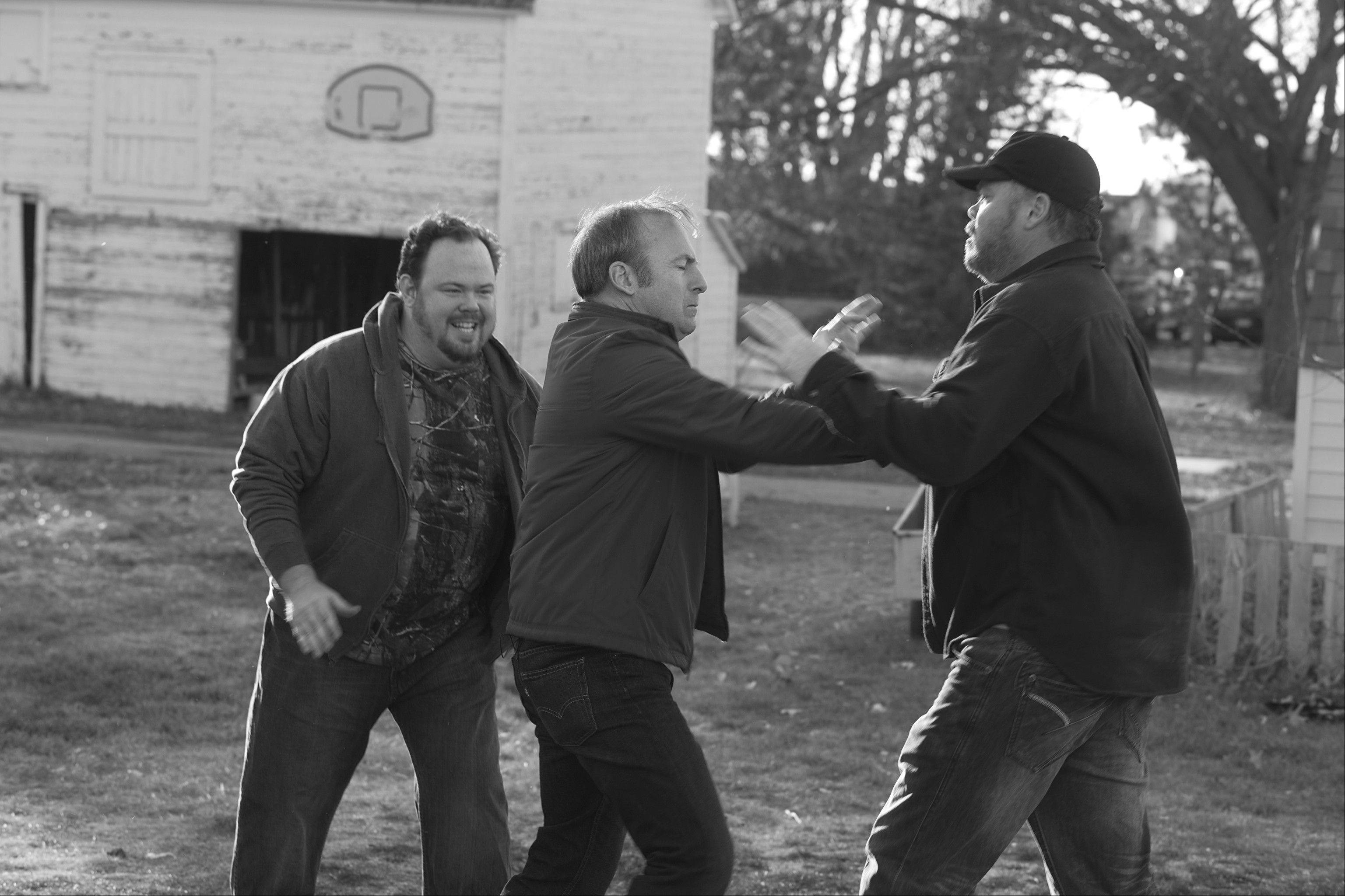 "In Alexander Payne's domestic drama ""Nebraska,"" Naperville native Bob Odenkirk, center, takes on some local bullies."