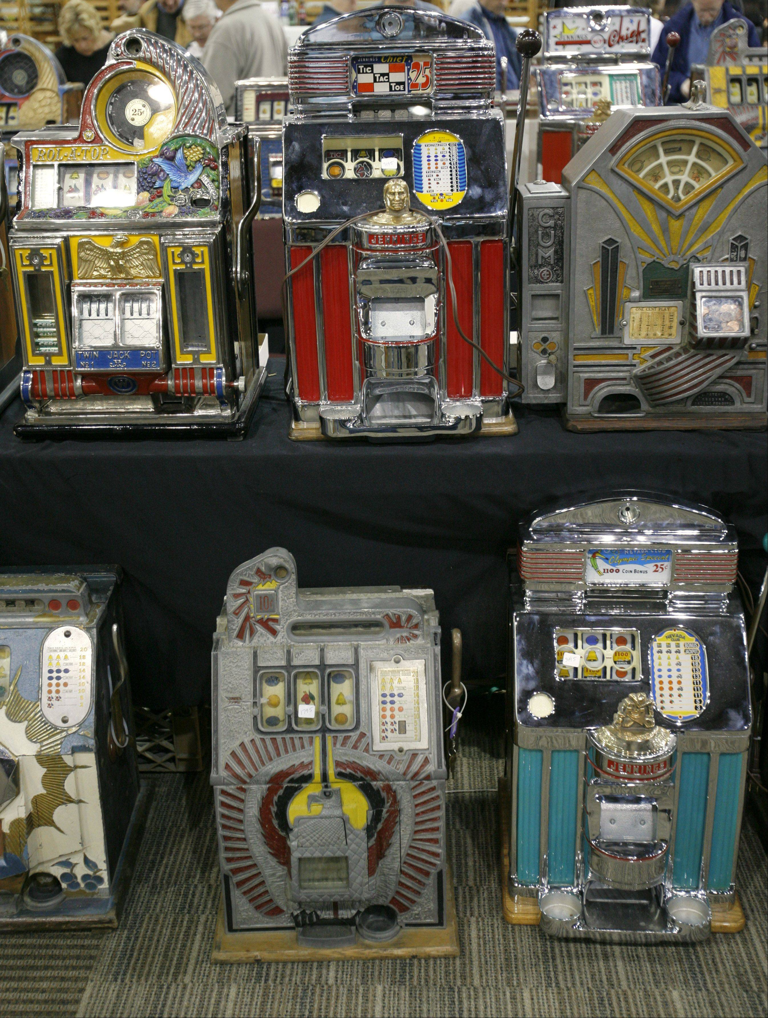 Vendors display a variety of antique slot machines during the Chicagoland Antique Advertising, Slot Machine and Jukebox Show, which returns to St. Charles at Pheasant Run Resort.