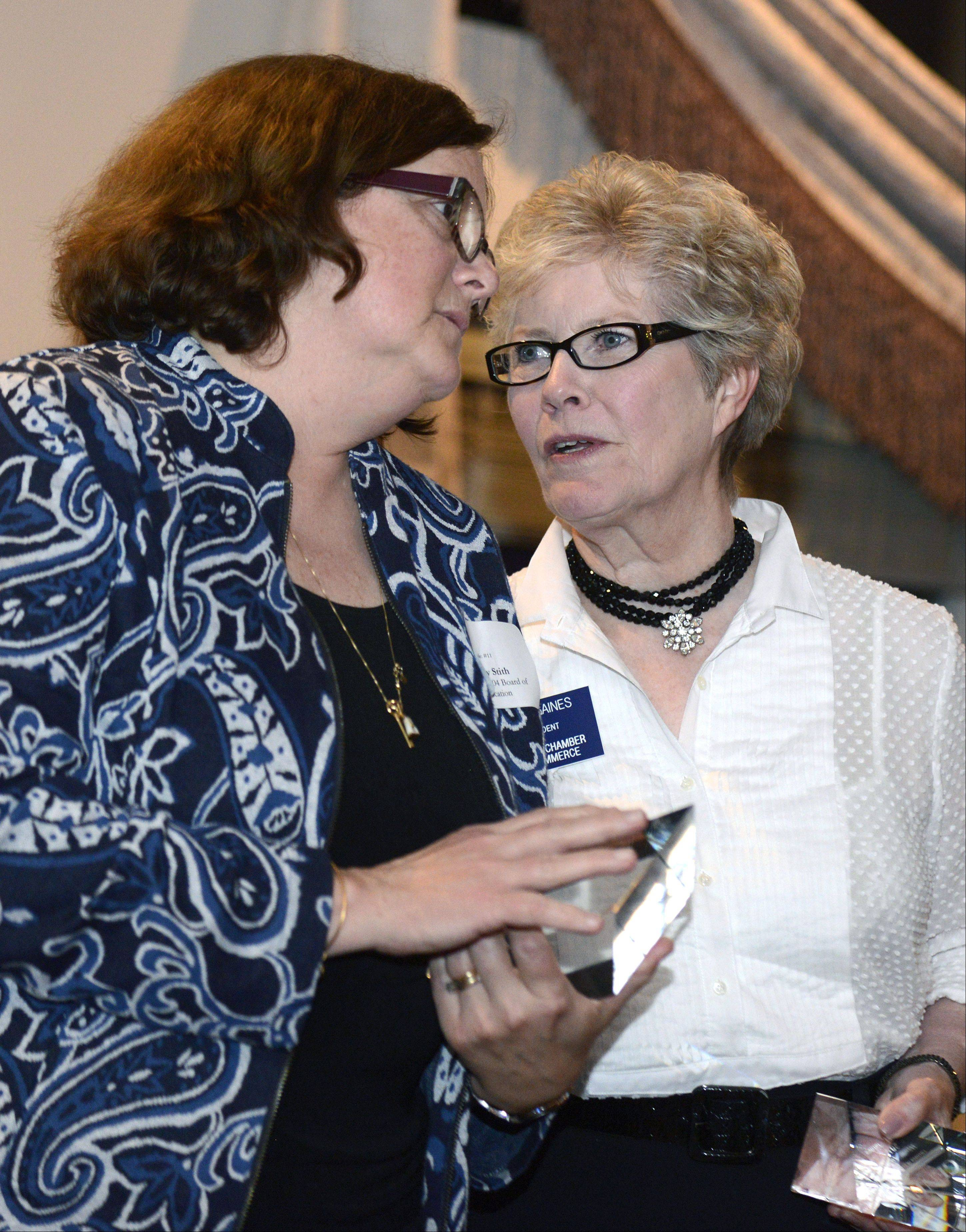 This year's Wood Award recipients. Geneva school board member Mary Stith, left, and Geneva chamber executive director Jean Gaines chat, onstage after receiving their awards at the Geneva Country Club on Tuesday.