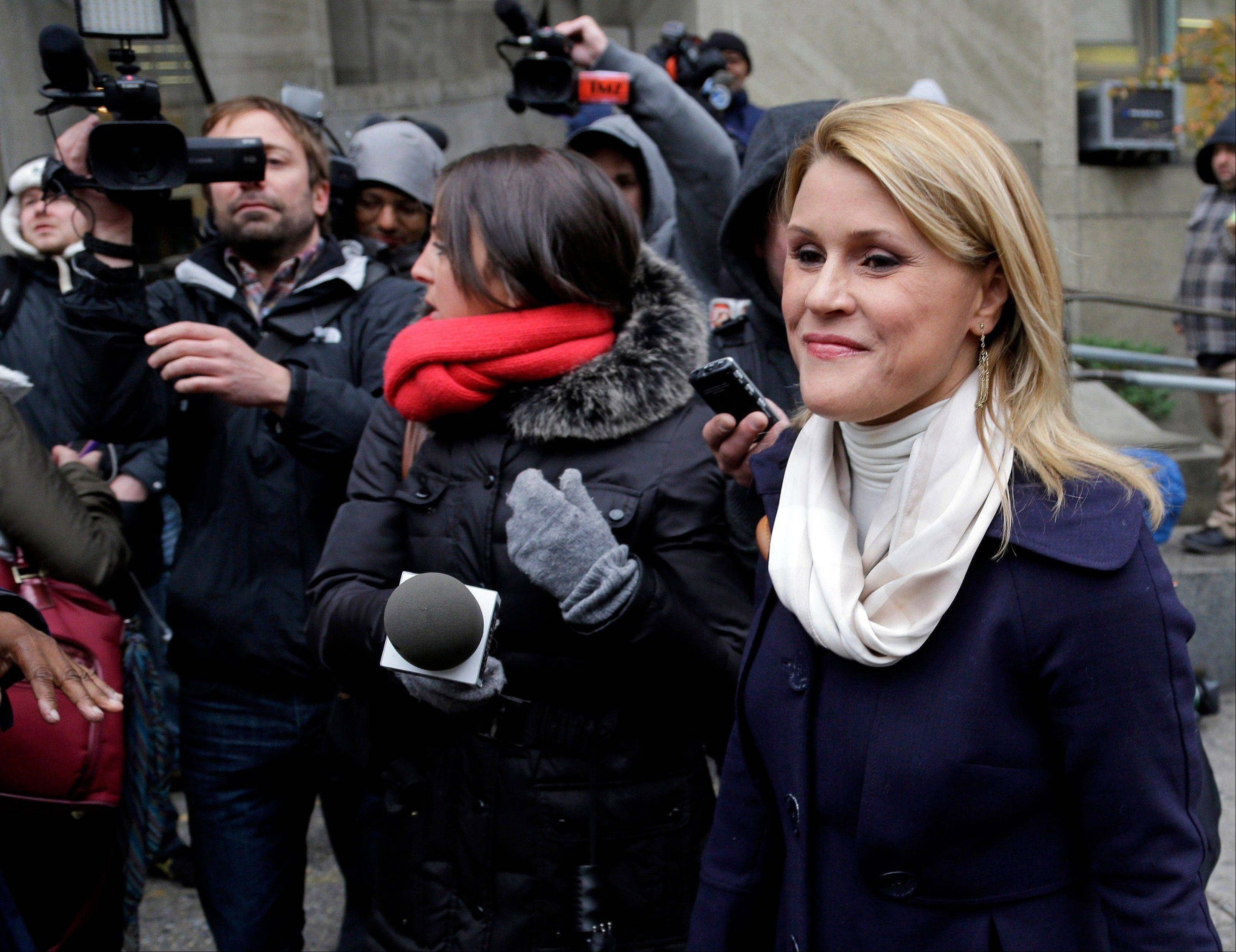 Genevieve Sabourin, who is charged with stalking actor Alec Baldwin, speaks with reporters as she arrives for her trial.