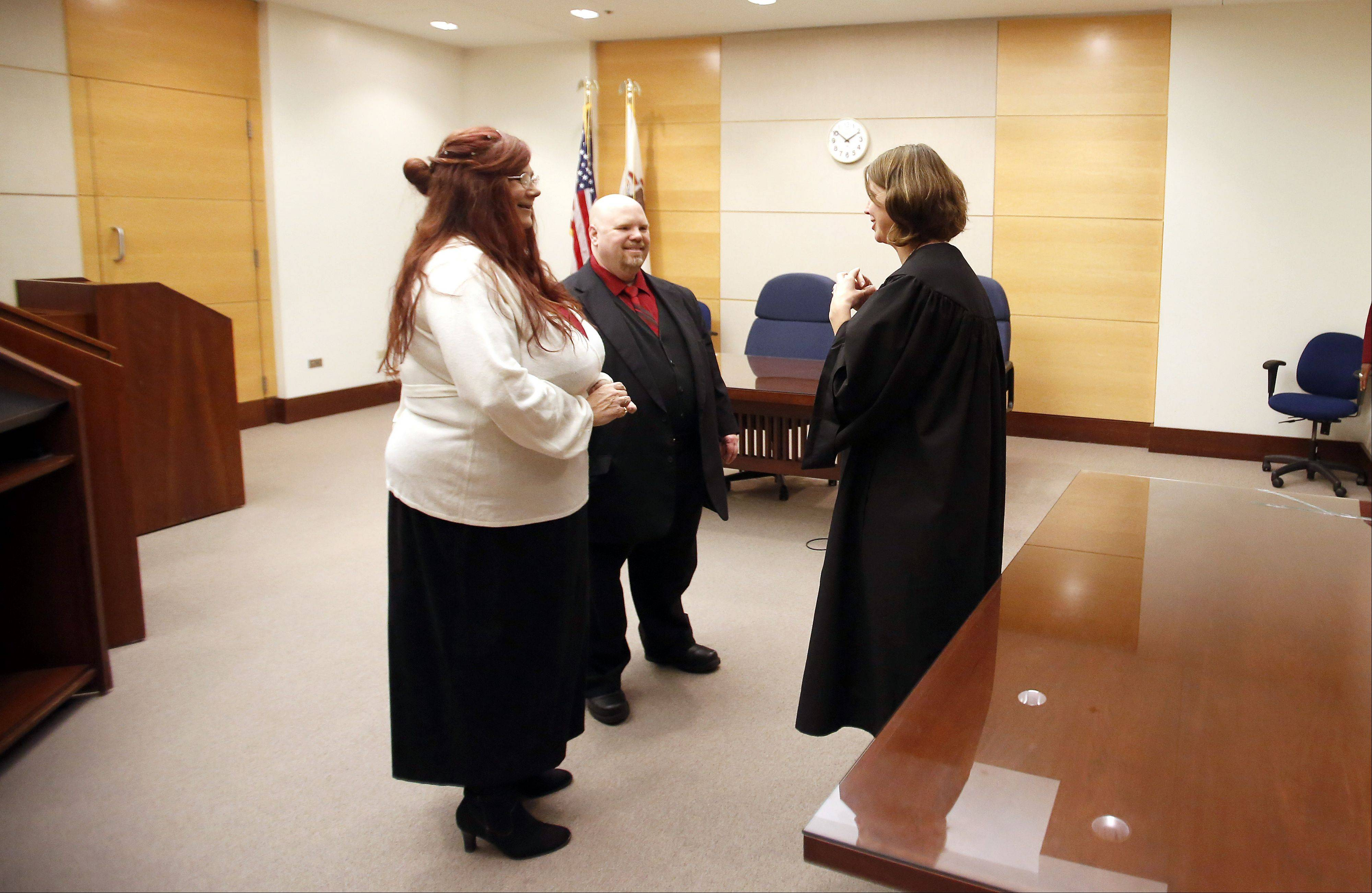 Judge Christine Downs performs the ceremony for Robert and Vanessa Szumal of Naperville, who were married at the Kane County Courthouse Tuesday, 11-12-13, in St. Charles.