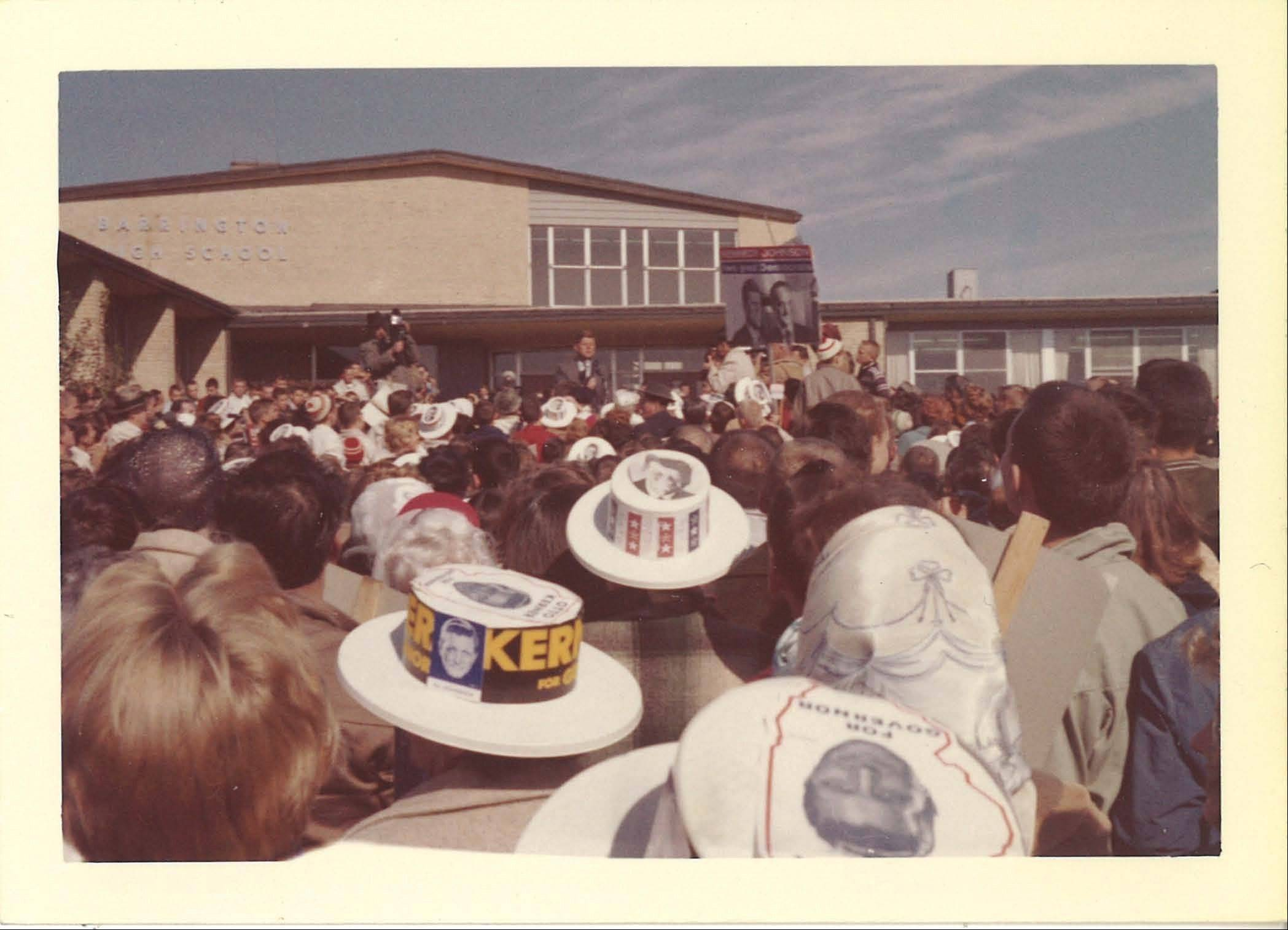 Sen. John F. Kennedy speaks from the front steps of Barrington High School less than two weeks before being elected president, in a newly found photo that's part of a collection to be unveiled Thursday, Nov. 21 at the school.