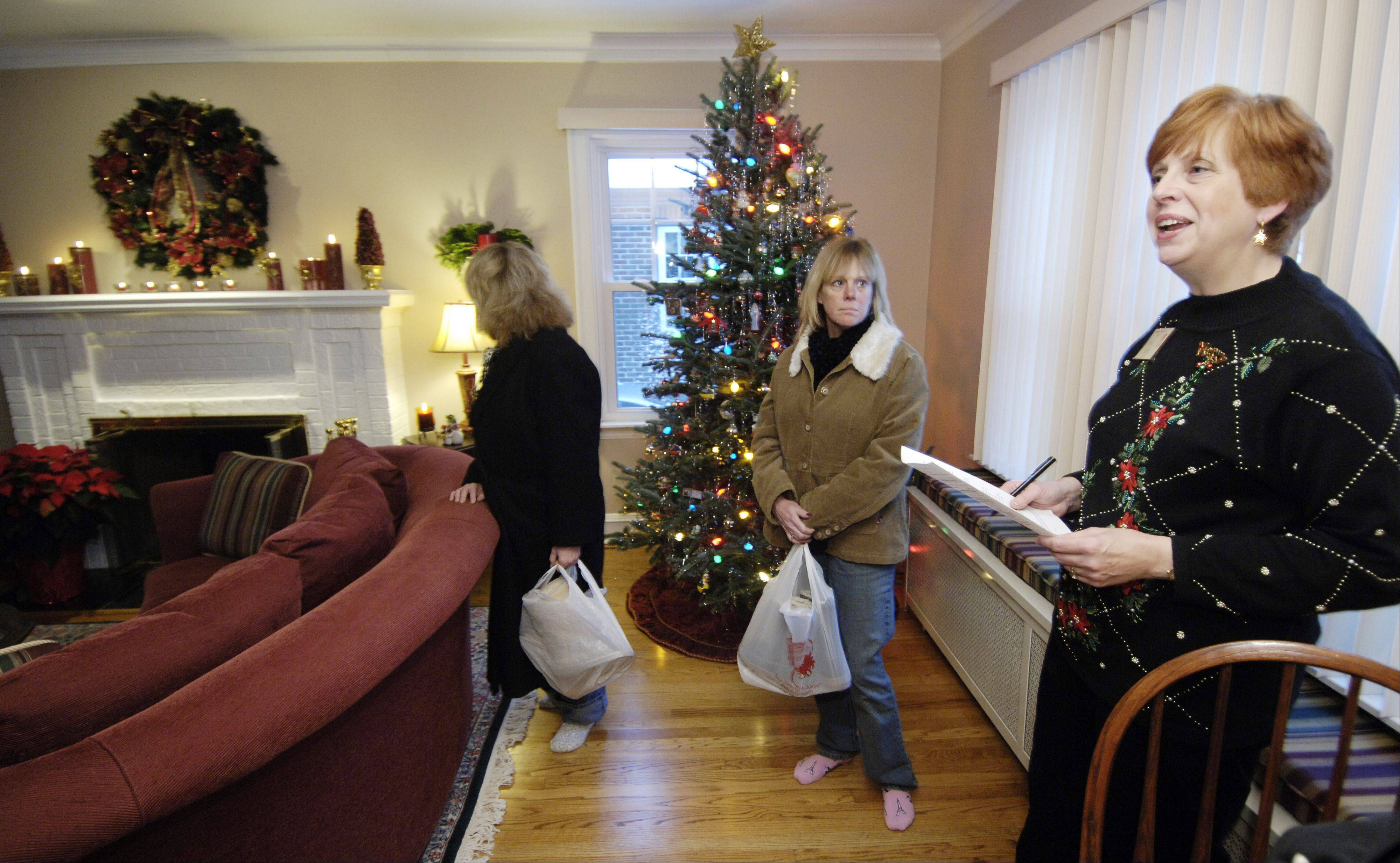 Arlene Juracek, now the mayor of Mount Prospect, greets visitors to one of the home in the historical society's 2006 holiday housewalk. The event is the group's biggest fundraiser of the year