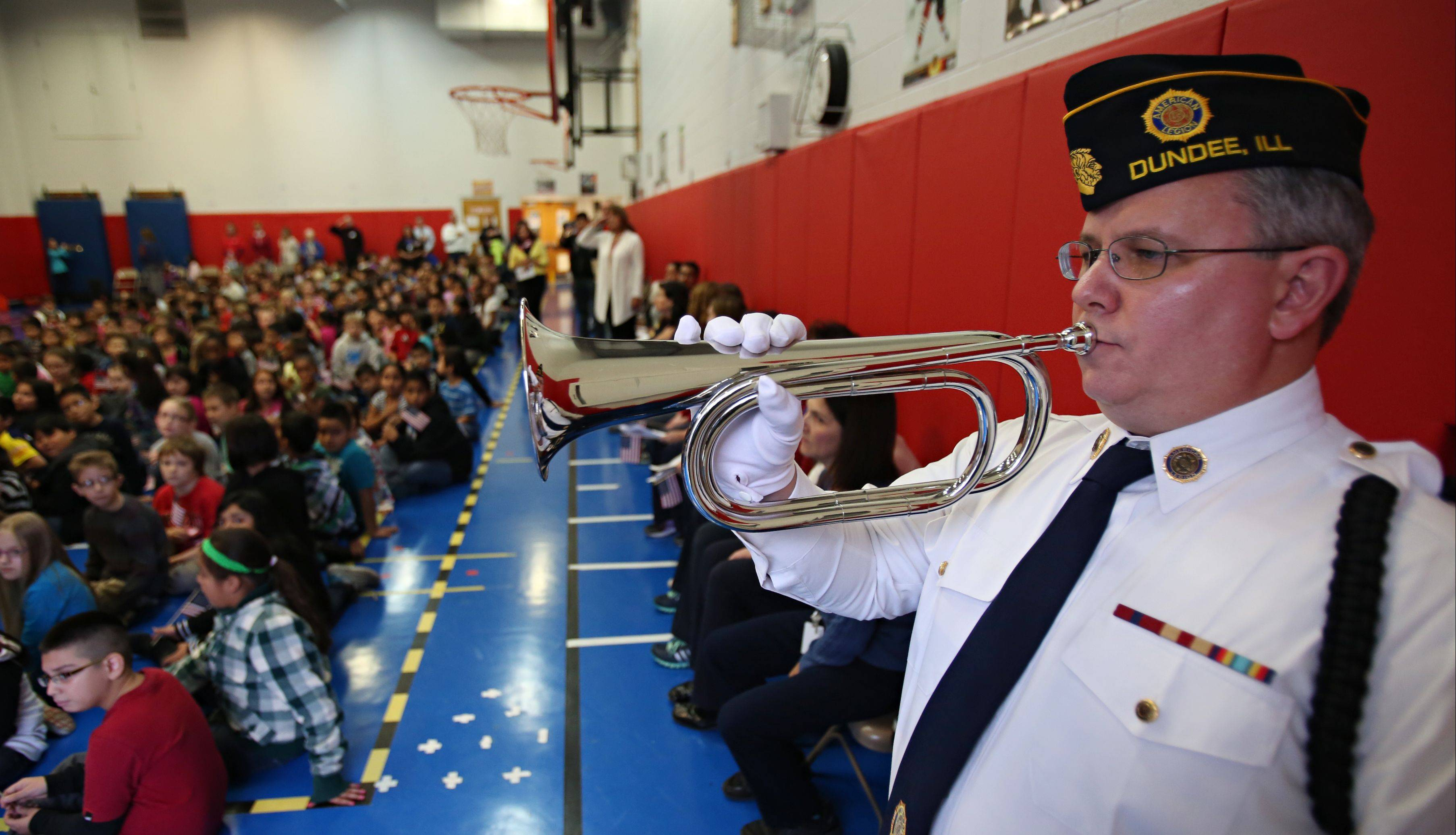Marine Corps veteran and bugler Don Moore plays taps during the Veterans Day ceremony Monday at Parkview Elementary in Carpentersville. His daughter Gayle played the echo trumpet along with him. Moore is a member of the American Legion Post 679.