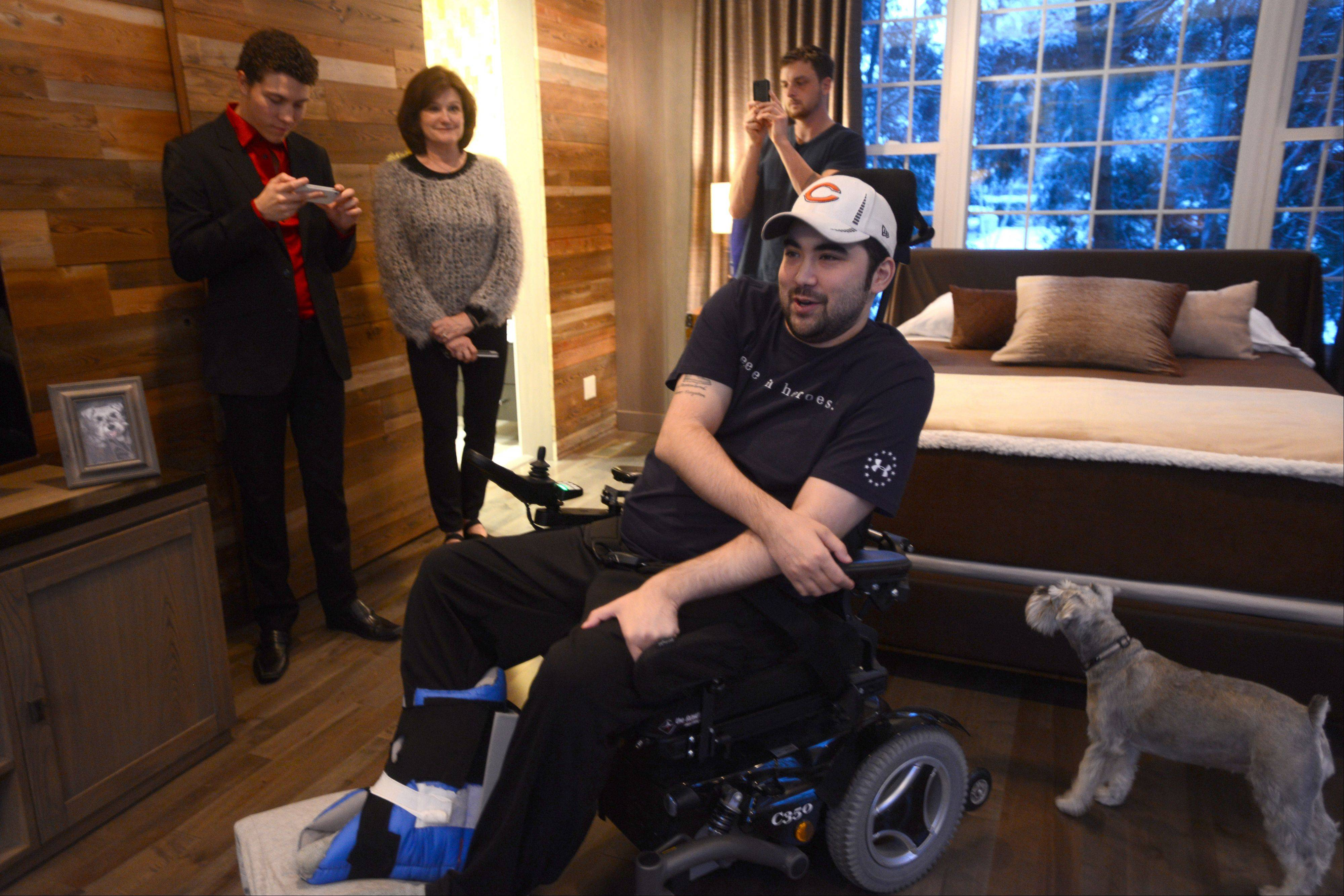 Dan Tsutsumi took a first look at a makeover of his Arlington Heights home on Monday afternoon. Tsutsumi, a veteran who served tours of duty in Iraq, was paralyzed after a swimming accident which occurred after his time of military service.