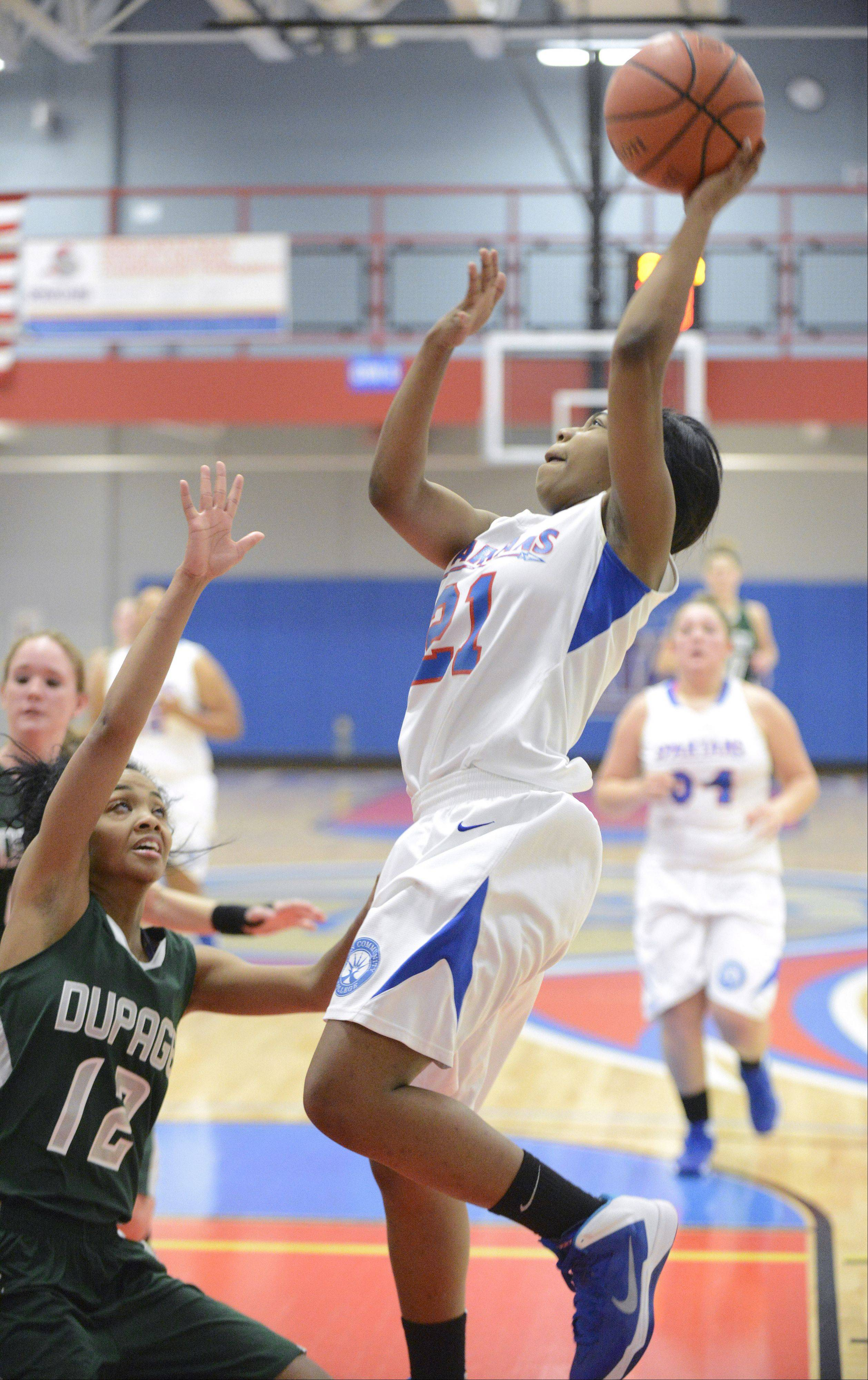 Elgin Community College's Erica Haynes shoots over a block by College of DuPage's Breanna Venson in the second half on Tuesday.