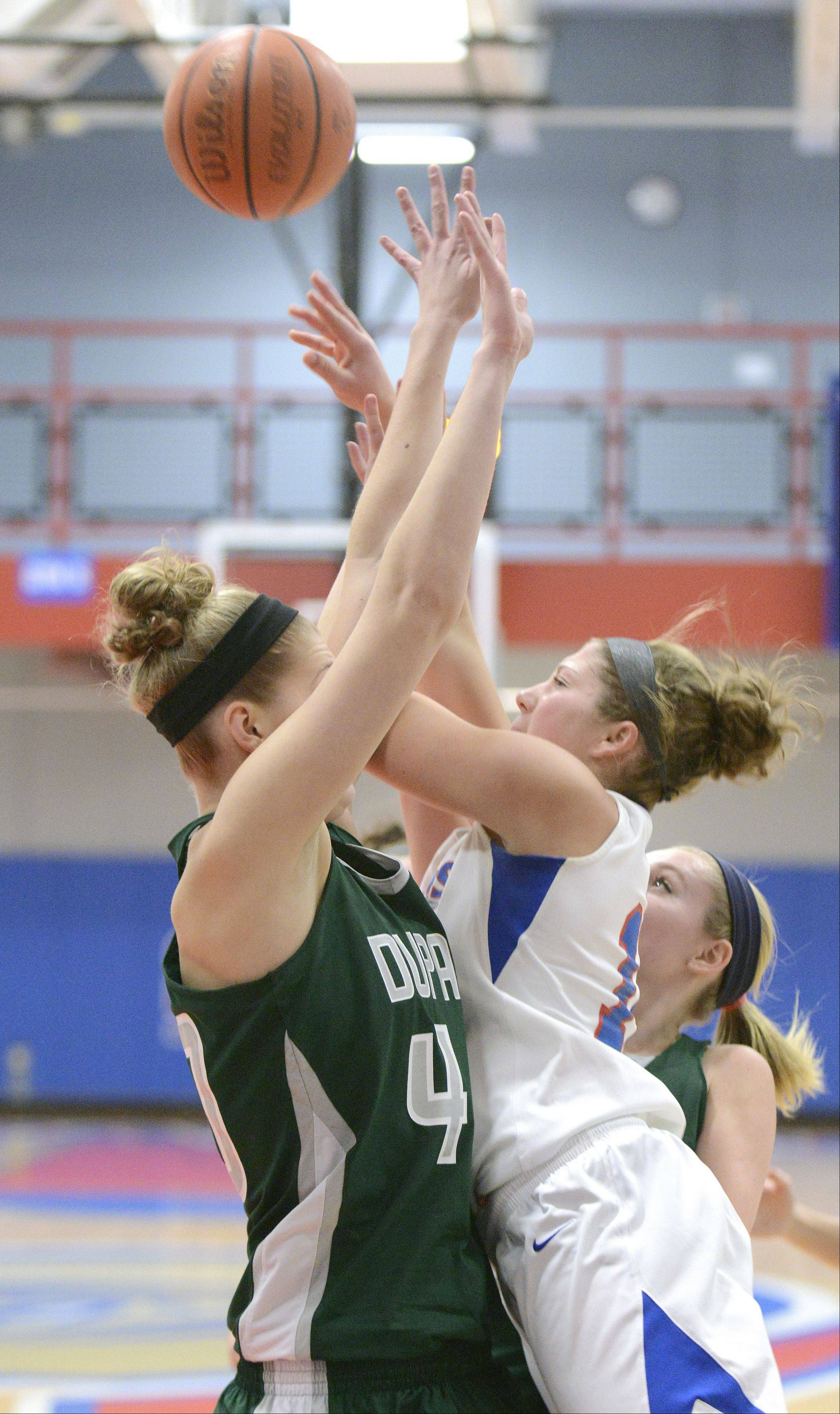 Elgin Community College's Jen Dumoulin, right, smashes into College of DuPage's Melissa Niggins while going up to the hoop in the second half on Tuesday.